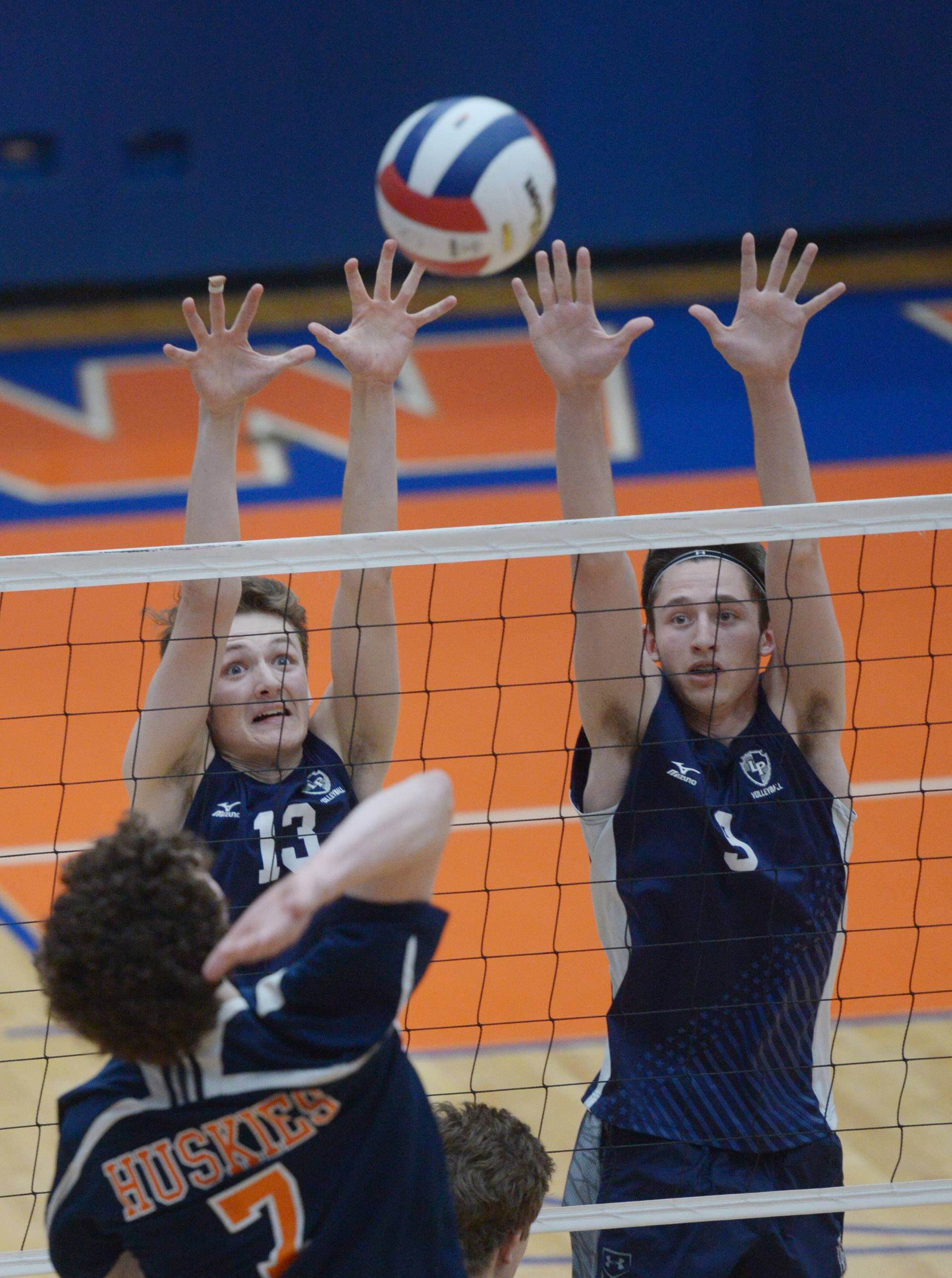 Lake Park's Josh Lange, left, and Austin Bayner attempt to block a ball hit by Oak Park-River Forest's Kyle Rasmussen during the boys volleyball state quarterfinals at Hoffman Estates High School Friday.