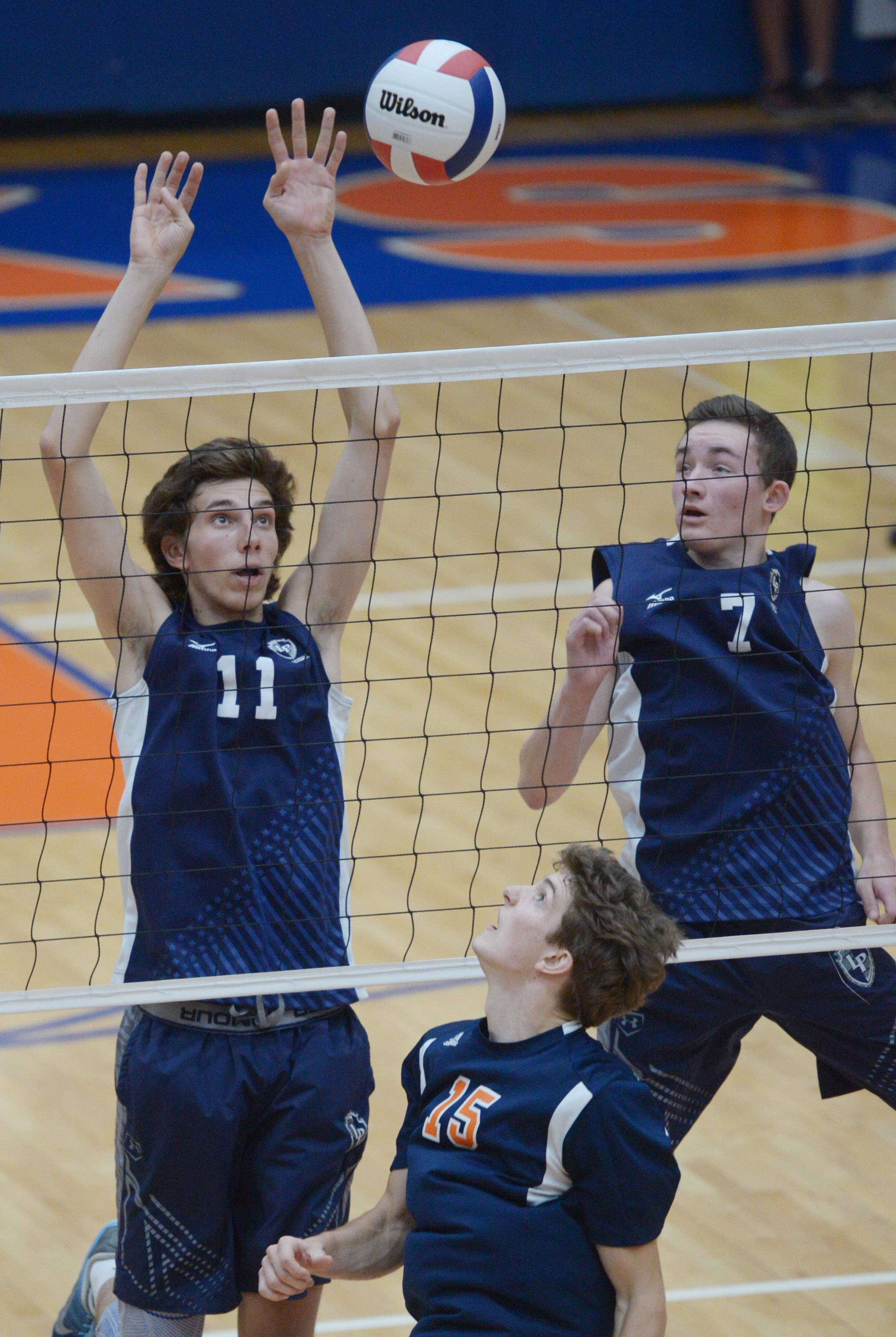 Lake Park's Nick Martinski, left, and Jack Fischer block a ball hit by Oak Park-River Forest's Ben Hancock (15) during the boys volleyball state quarterfinals at Hoffman Estates High School Friday.