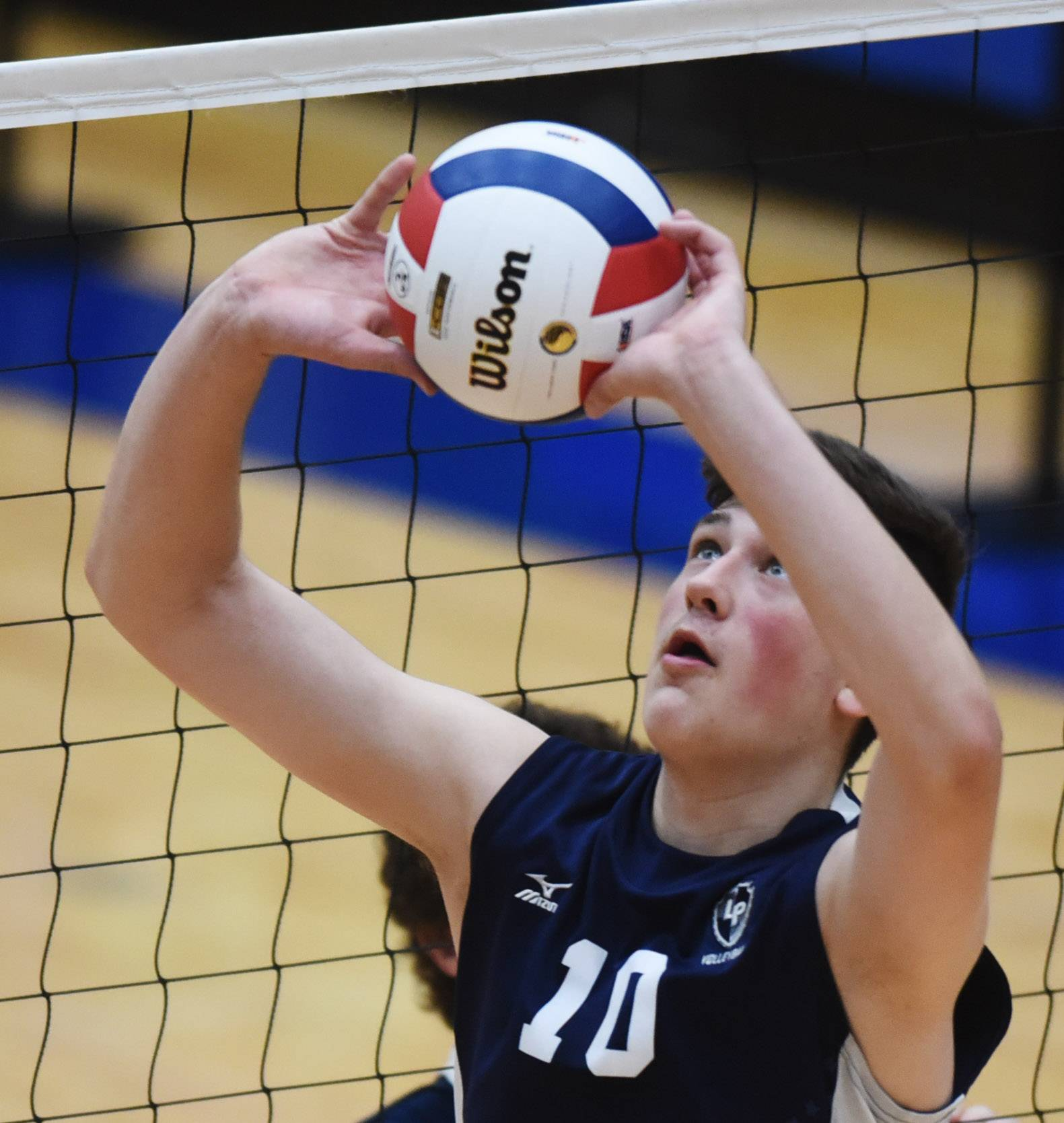 Lake Park's Justin Yost sets the ball during the boys volleyball state quarterfinals match against Oak Park-River Forest at Hoffman Estates High School Friday.