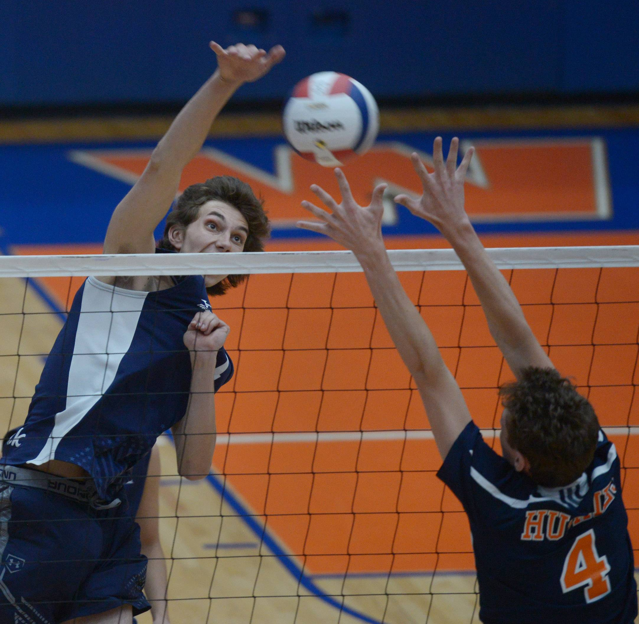 Lake Park's Nick Martinski (11) leaps for a kill as Oak Park-River Forest's Evan Bebe tries to block the ball at the net during the boys volleyball state quarterfinals at Hoffman Estates High School Friday.