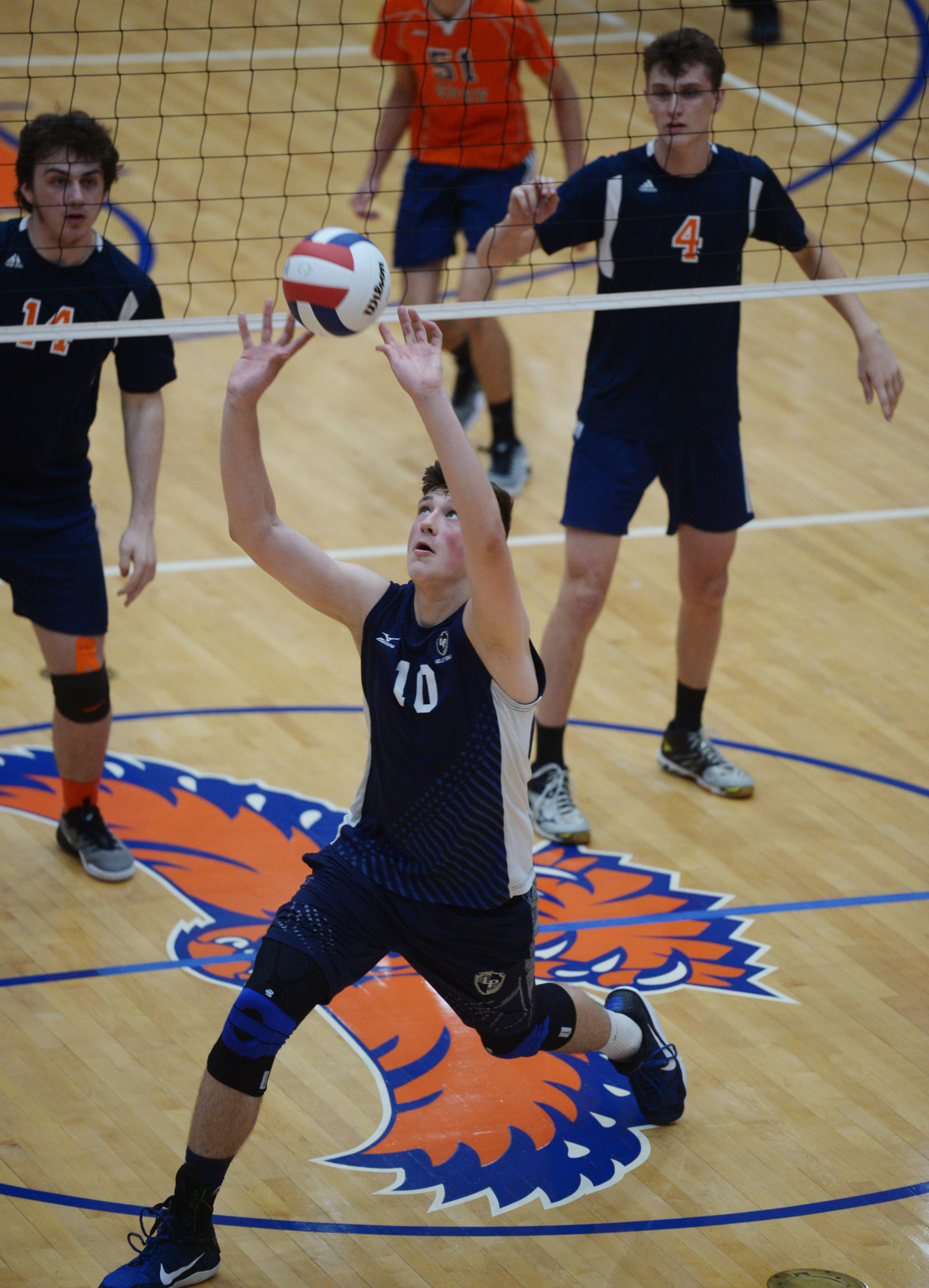 Lake Park's Justin Yost hustles to keep the ball in play during the boys volleyball state quarterfinals match against Oak Park-River Forest at Hoffman Estates High School Friday.