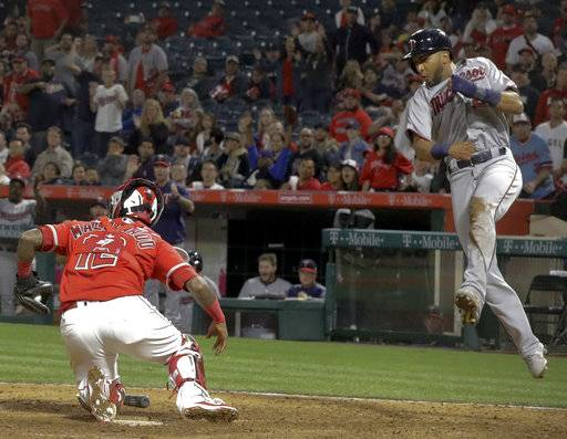 Twins turn triple play, rally in ninth to beat Angels, 4-2