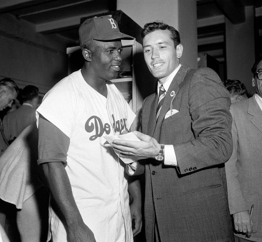 Jimmy Piersall, right, interviews Jackie Robinson in the Brooklyn Dodgers' dressing room at Ebbets field in Brooklyn.