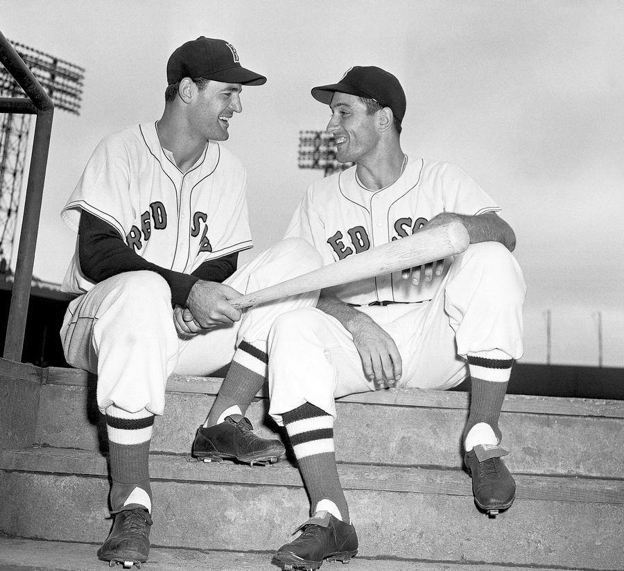Red Sox first baseman Walt Dropo gives a few pointers to outfielder Jimmy Piersall, who came up to the Red Sox on Aug. 30, 1950 from the Louisville Colonels.