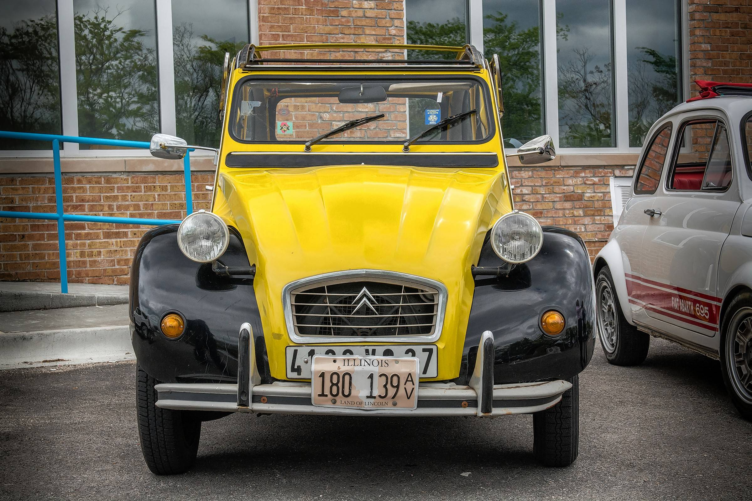 The 1976 Citroen 2CV features two-tone, Art-Deco inspired yellow and black paint.