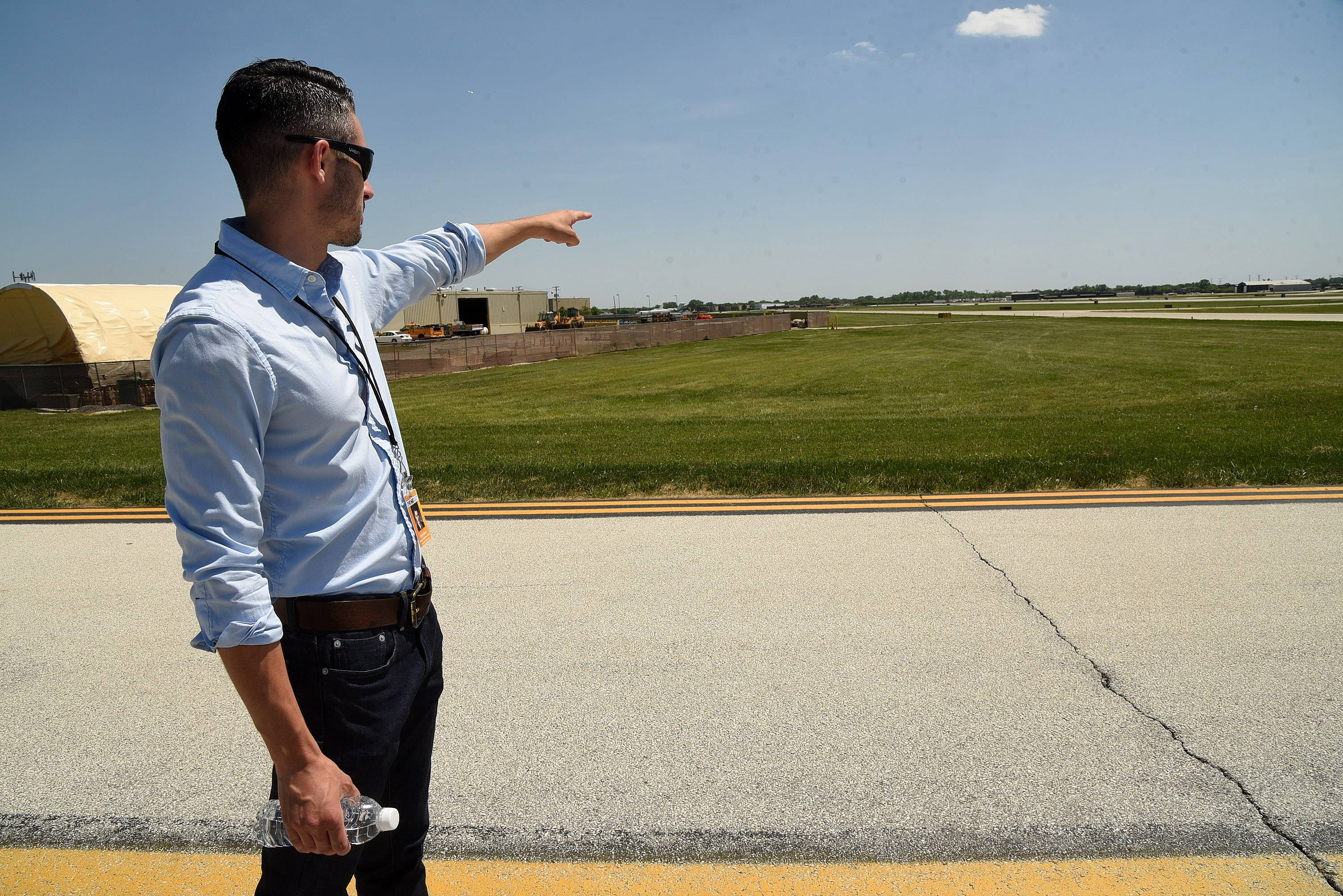 Bryce Walter, airport operations coordinator, points to where a drone was found near a Chicago Executive Airport runway.