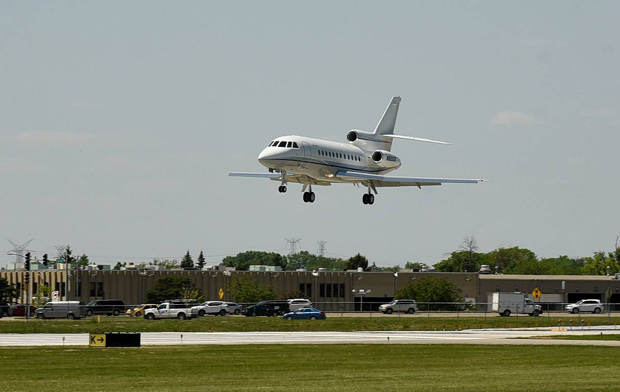 A jet lands at Chicago Executive Airport, which is conducting a public safety campaign about drones.