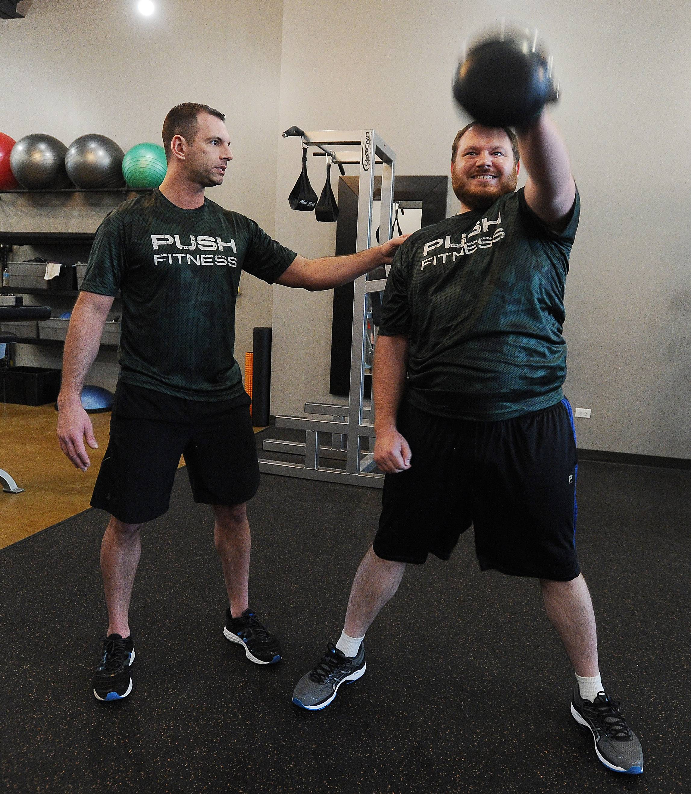 Amsden puts DeBouver through a workout at Push Fitness.