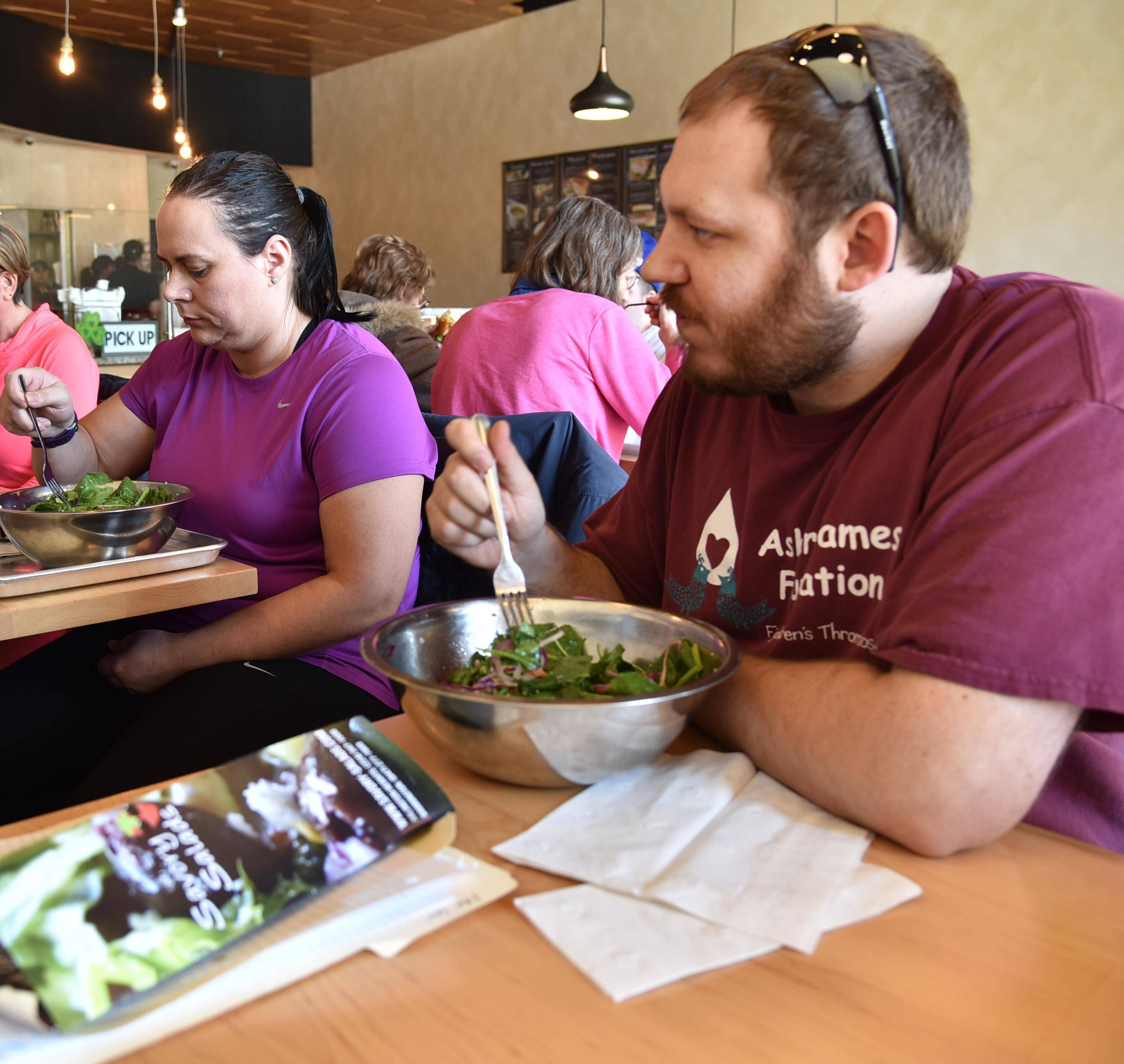 DeBouver talks with fellow Fittest Loser contestant Penny Brown at Savory Salads in Arlington Heights.