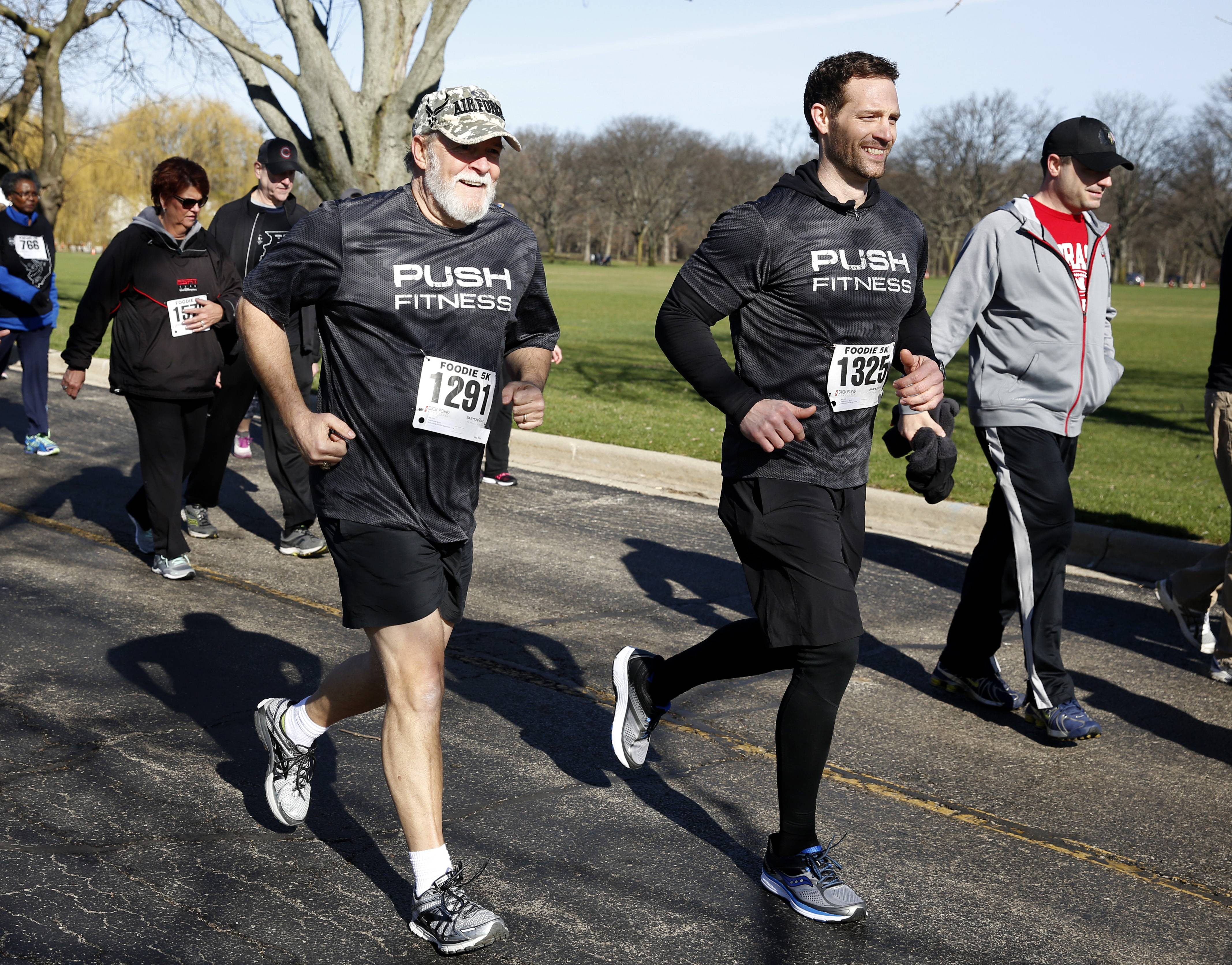 Russ Page, Fittest Loser contestant, runs with Push Fitness owner Josh Steckler in the Foodie 5K run at Cantigny Park in Wheaton.