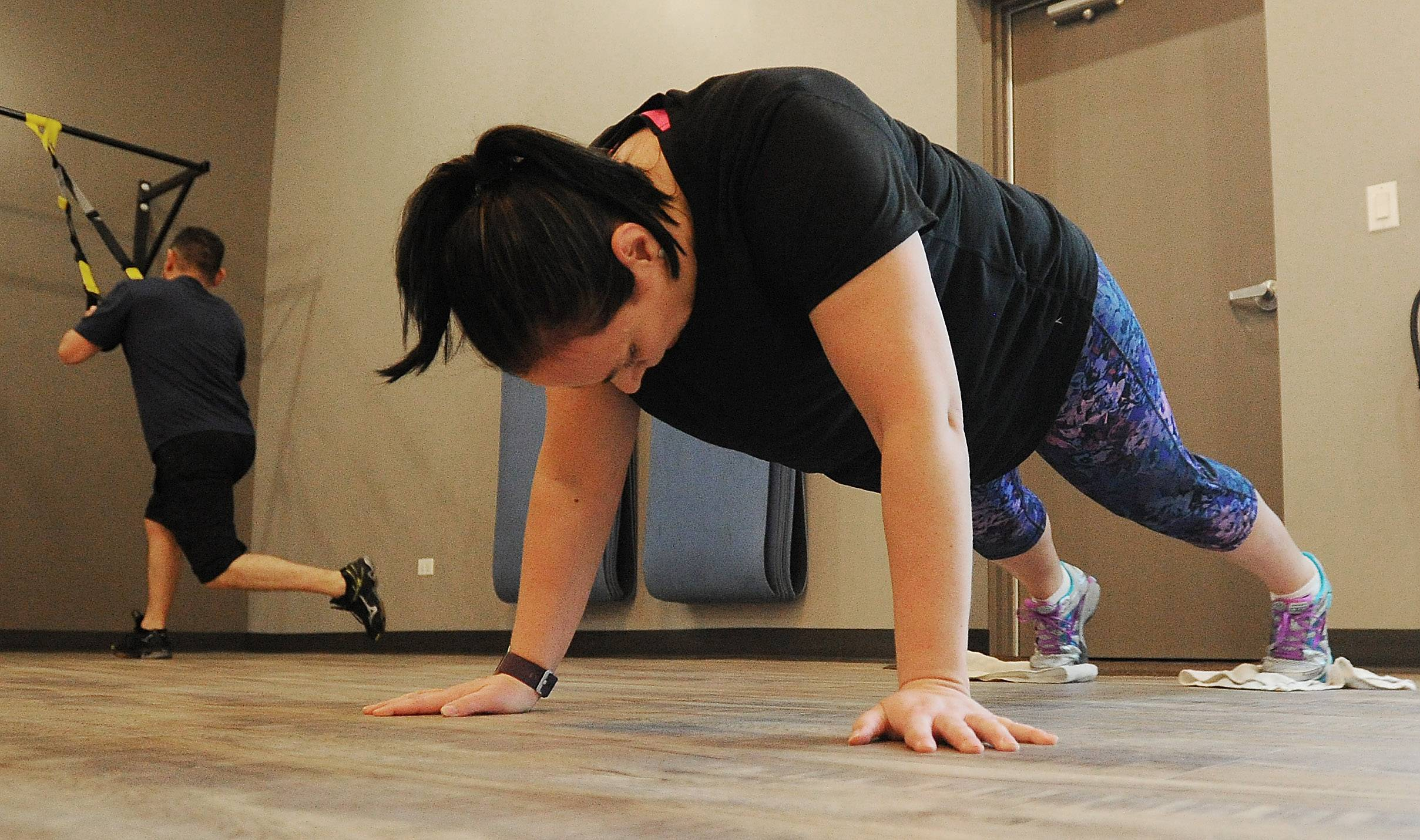 Penny Brown of Fox Lake halfway through the Fittest Loser Contest, holding a plank at Push Fitness.