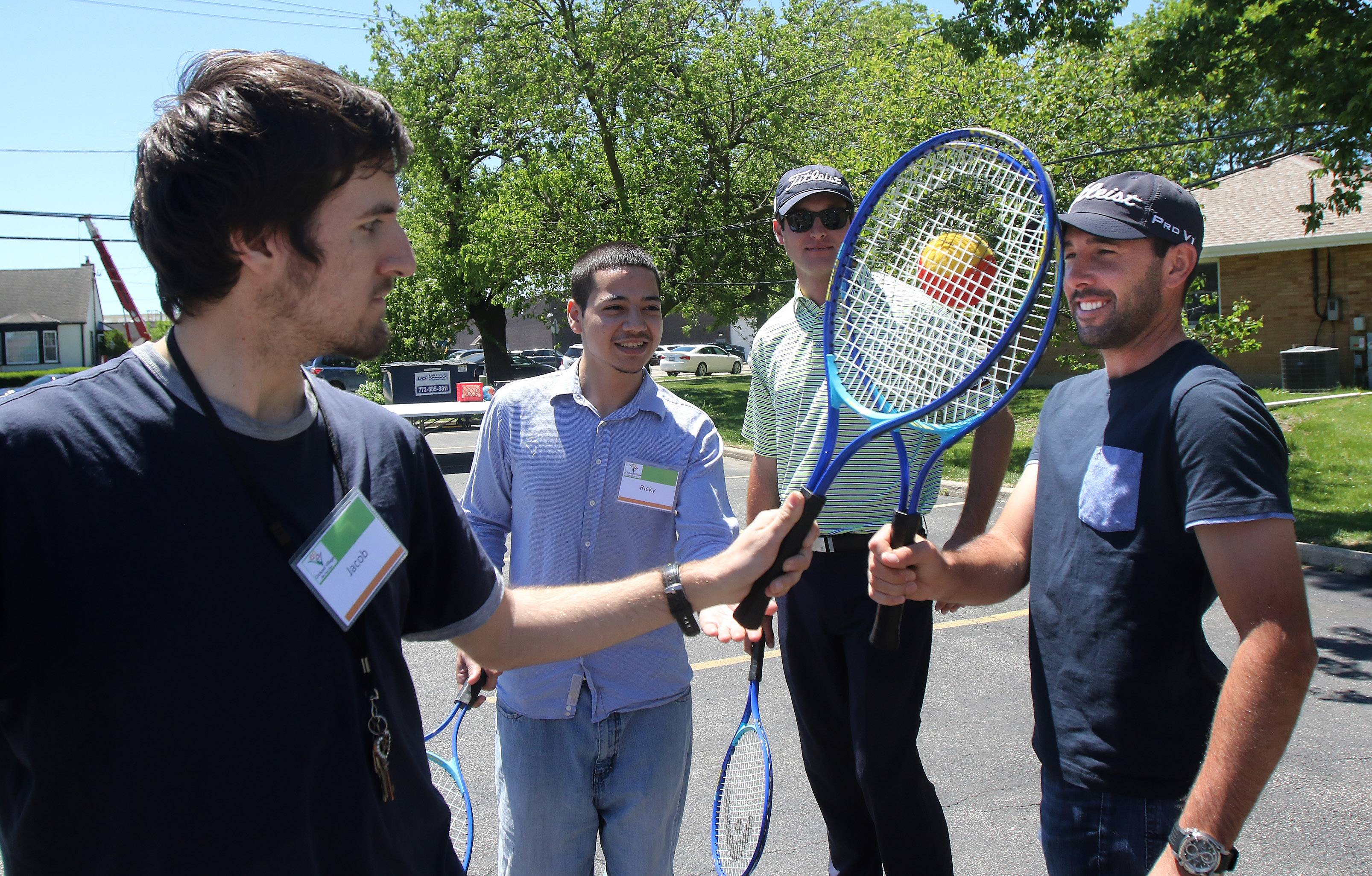 Resident Jacob Gotter, left, plays a game of adaptive tennis with golfer Michael Schachner of Libertyville on Tuesday, as golfers from the Rust-Oleum Championship met with residential clients at Orchard Village in Skokie.