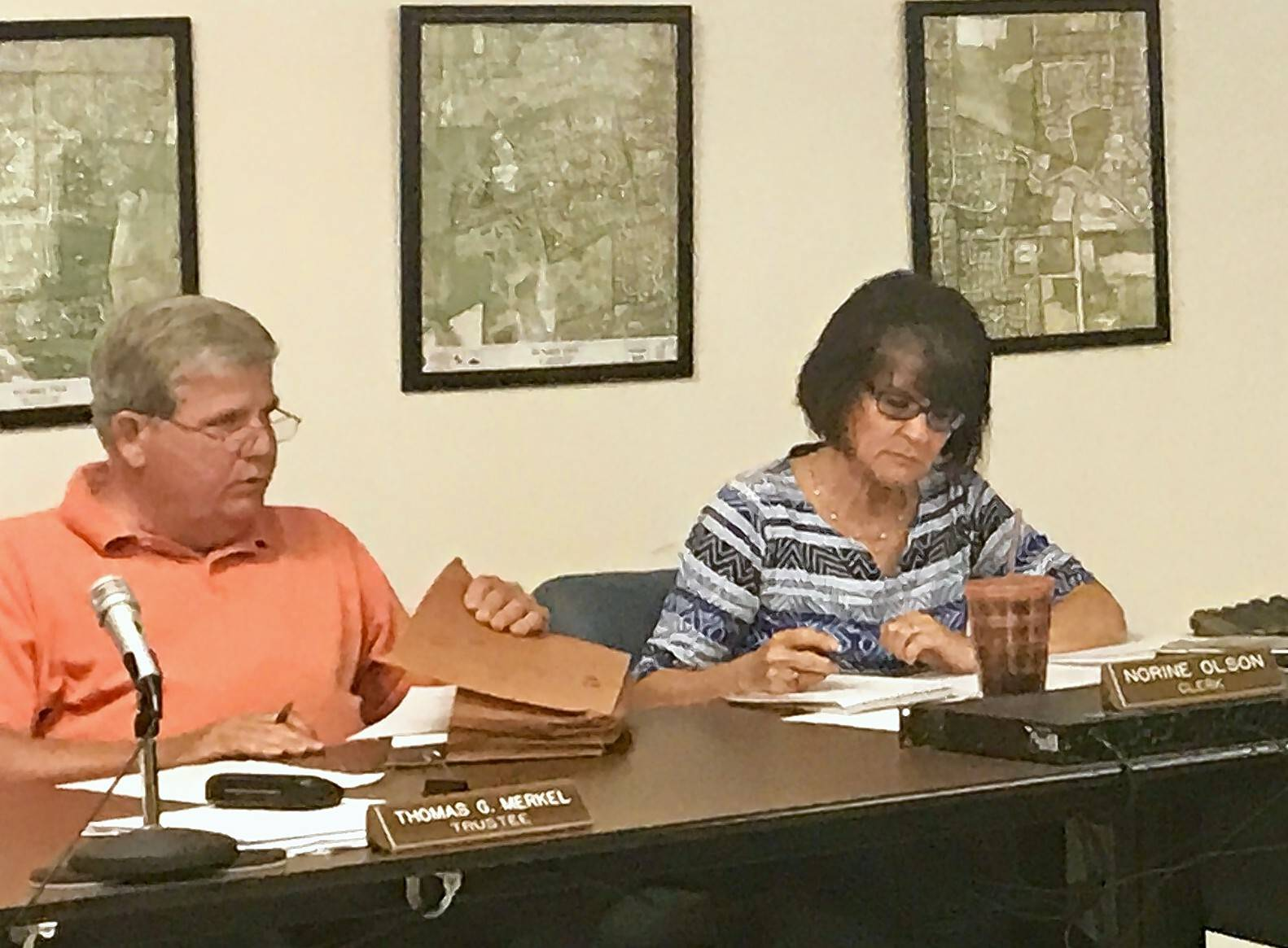 Sleepy Hollow Trustee Thomas Merkel, sitting beside Village Clerk Norine Olson, questioned the transparency and credibility of the village's attorney and top elected official during Monday's meeting.