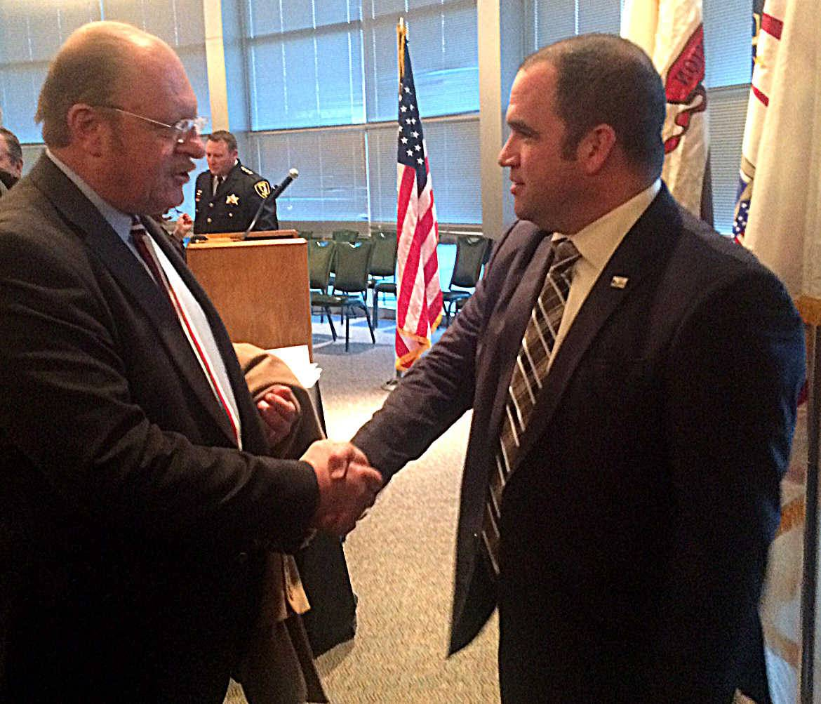 Former Elgin police Cmdr. Glenn Theriault, right, resigned as police chief in Sycamore Monday. Here, he is congratulated by Elgin Councilman Terry Gavin after a ceremony celebrating his retirement in December 2014.