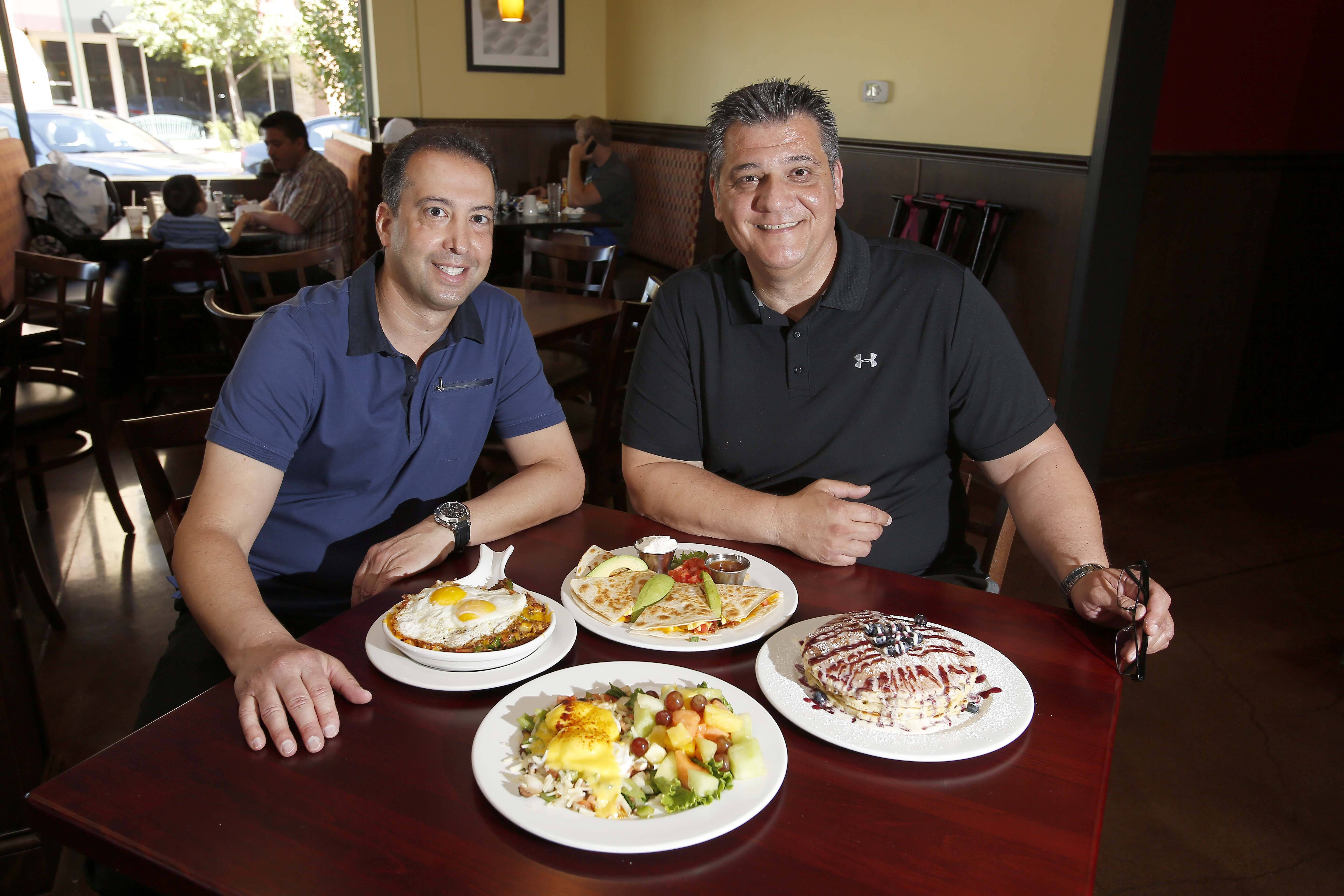 Co-owner Andy Zatos, left, and manager Frank Paganis show off a couple of the delectable dishes at Brunch Cafe in St. Charles.