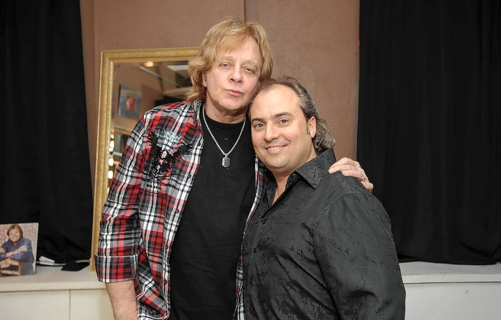 Singer Eddie Money, left, a former New York City police officer, with Arcada Theatre owner Ron Onesti.