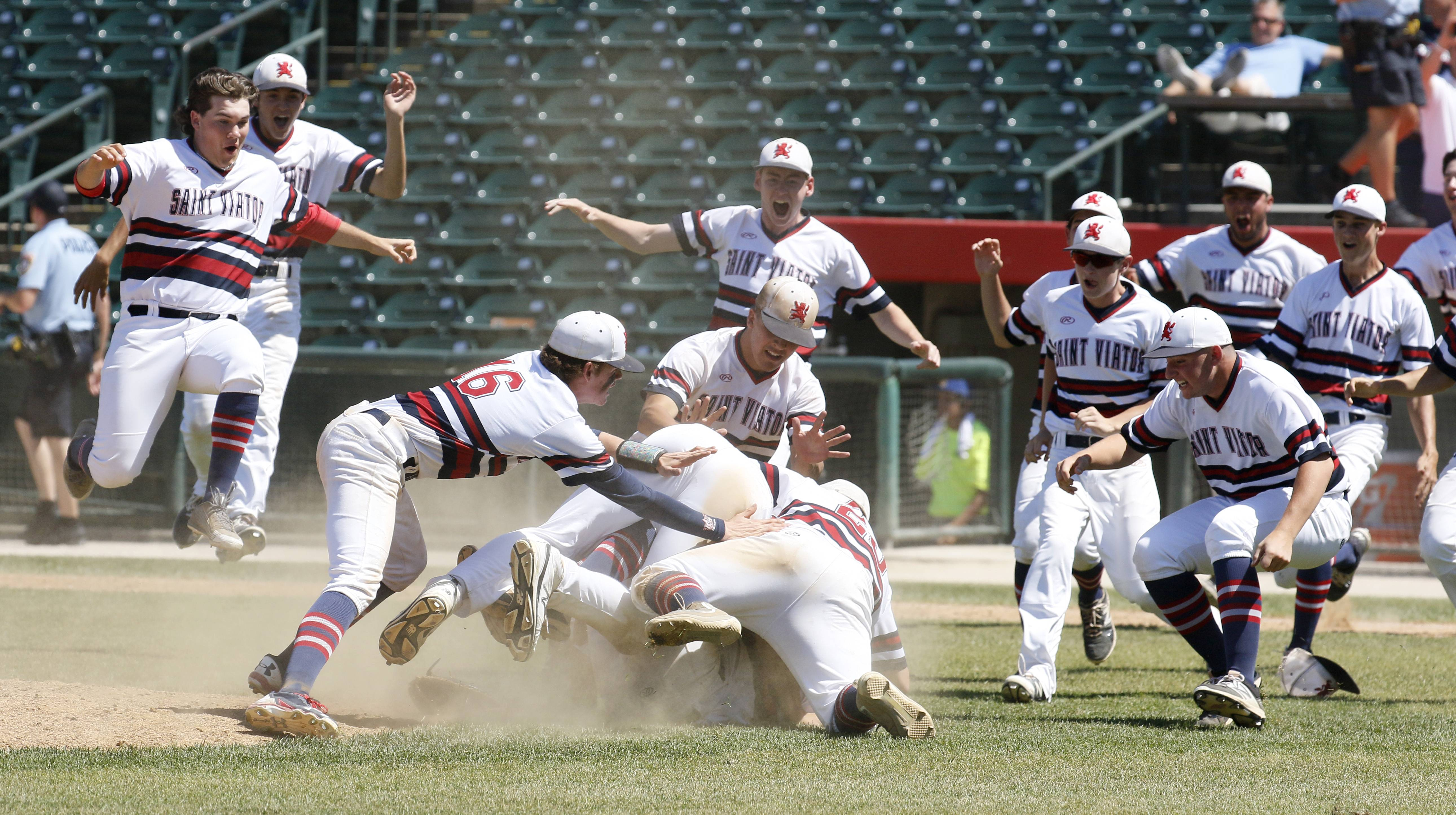 St. Viator players celebrate their Class 3A state championship with a 10-8 win over Marian Catholic on Saturday in Joliet.