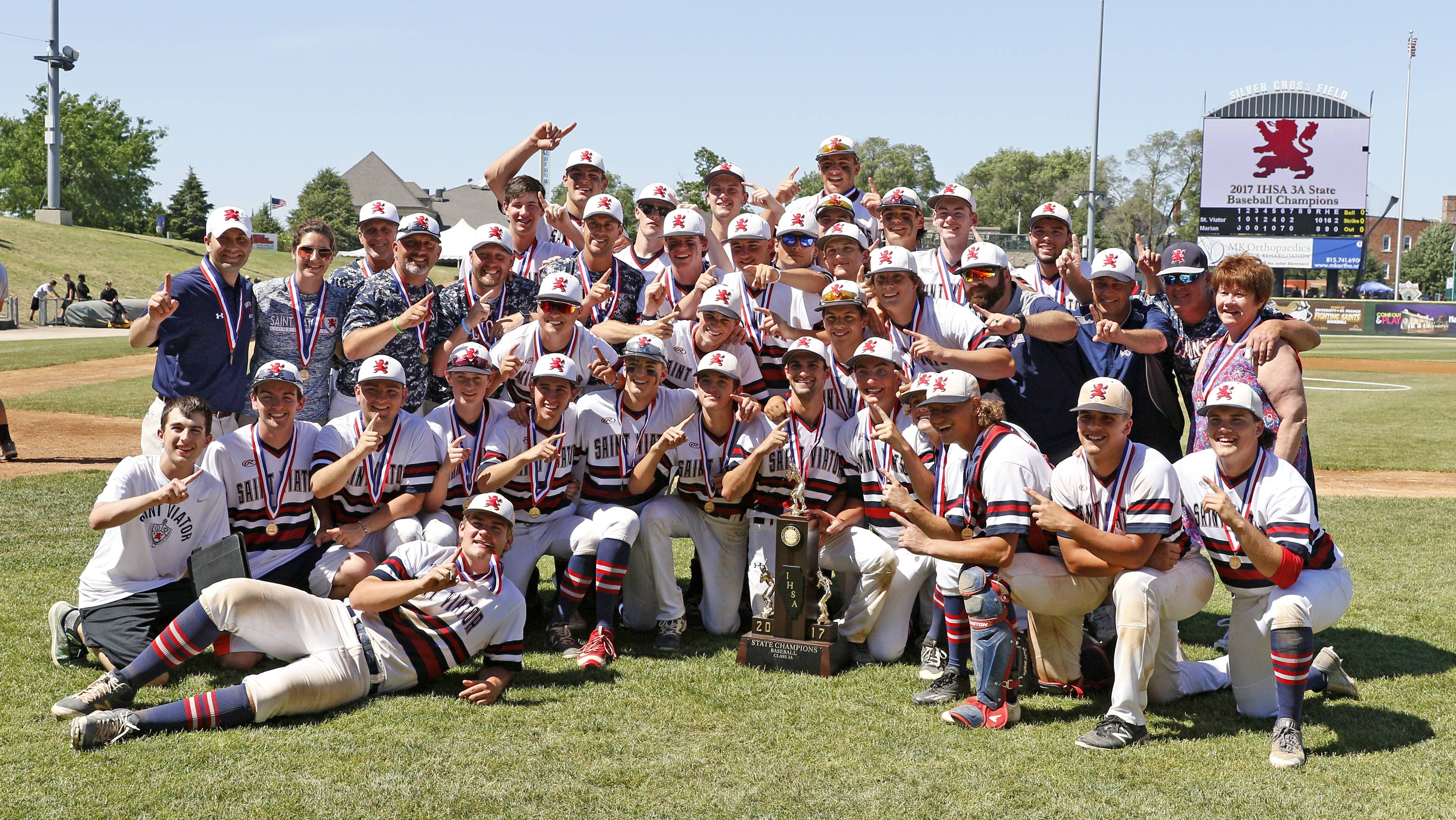 St. Viator baseball players celebrate their Class 3A state championship with a 10-8 win over Marian Catholic on Saturday in Joliet.