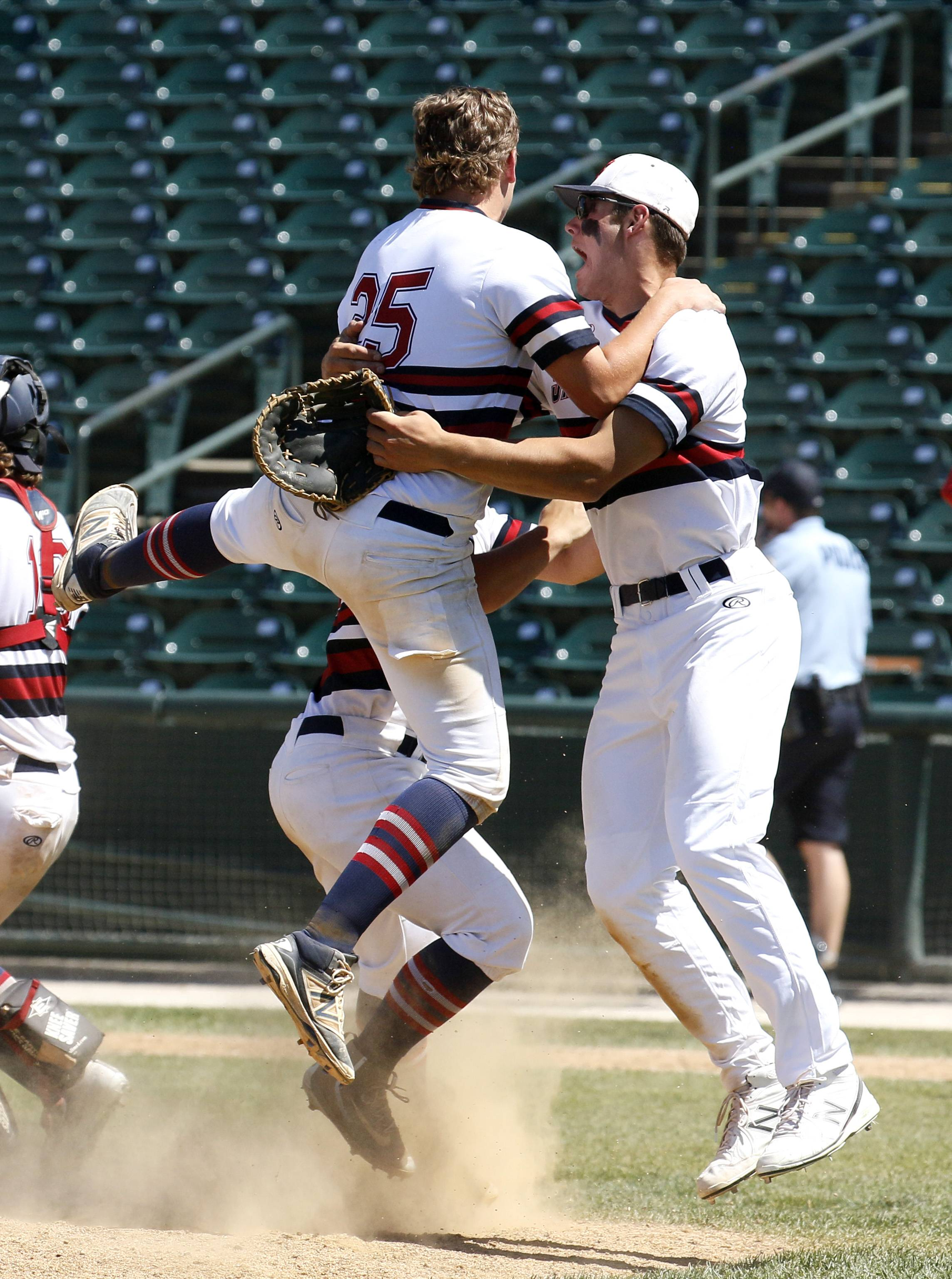 St. Viator's Brett De Selm, left, and Cole Kmet, right, celebrate their Lions' Class 3A state championship after their 10-8 win over Marian Catholic on Saturday in Joliet.
