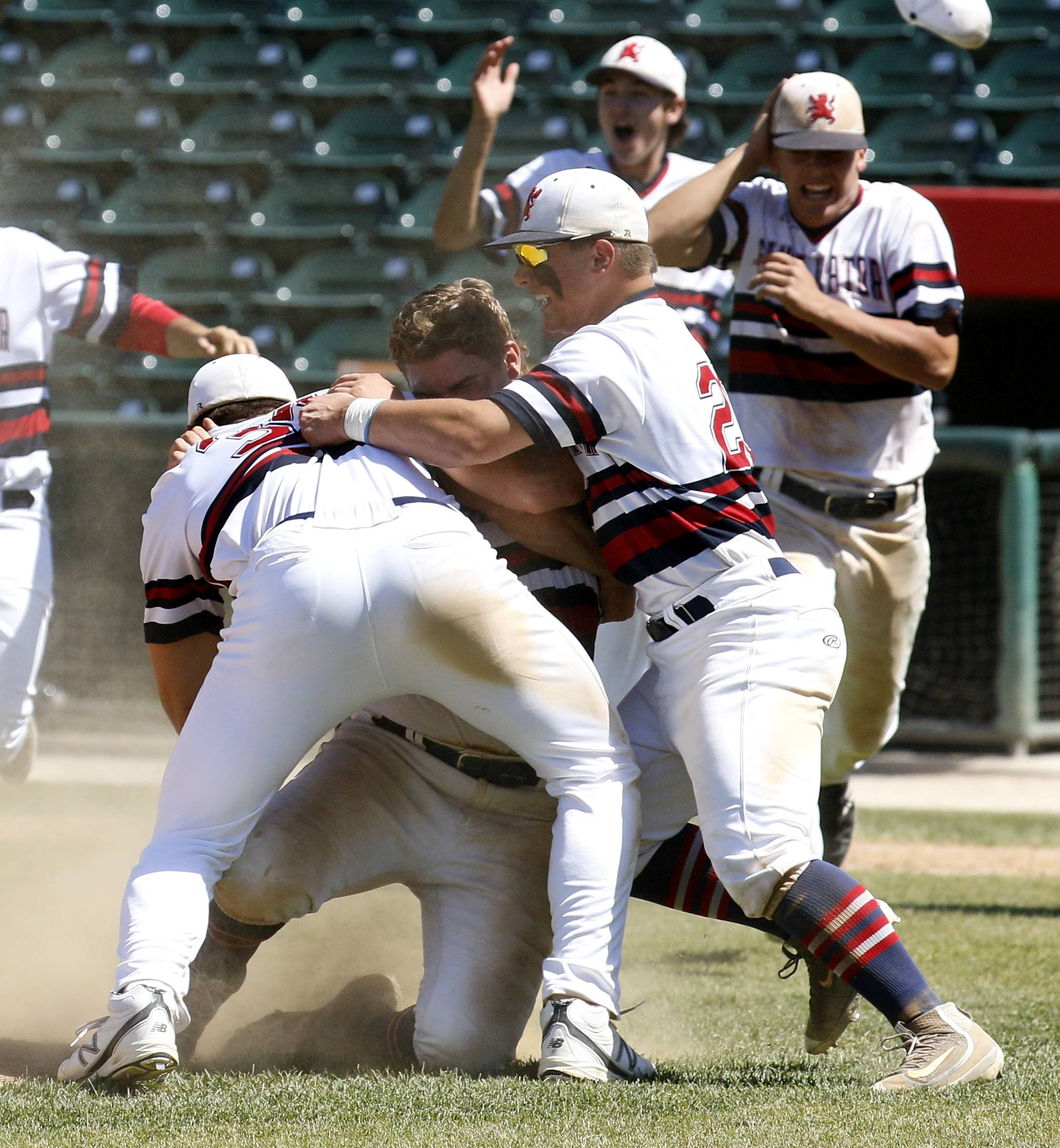 St. Viator players celebrate Class 3A state championship after a 10-8 win over Marian Catholic on Saturday in Joliet.