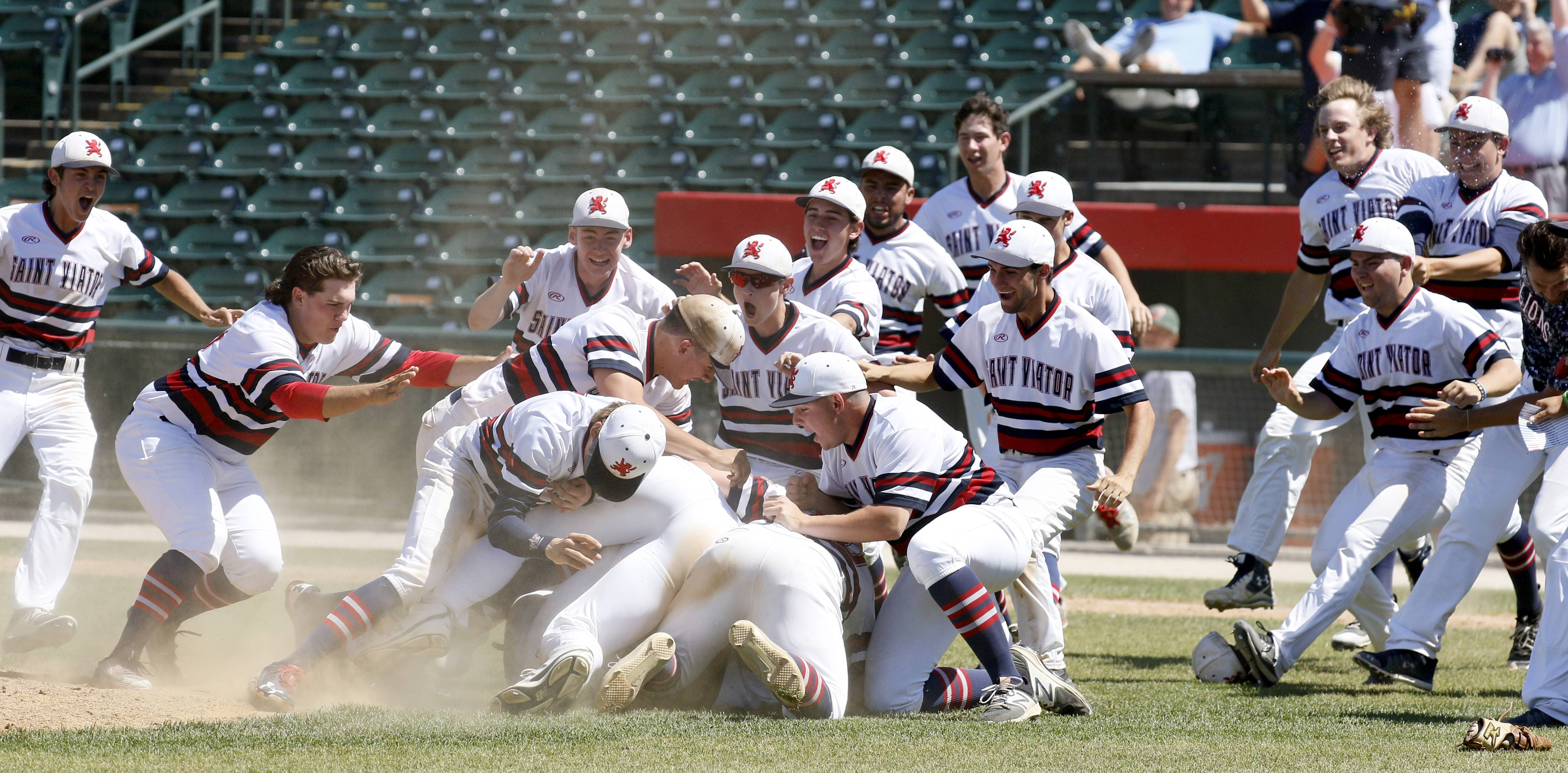 St. Viator players celebrate their Class 3A state championship after a 10-8 win over Marian Catholic on Saturday in Joliet.