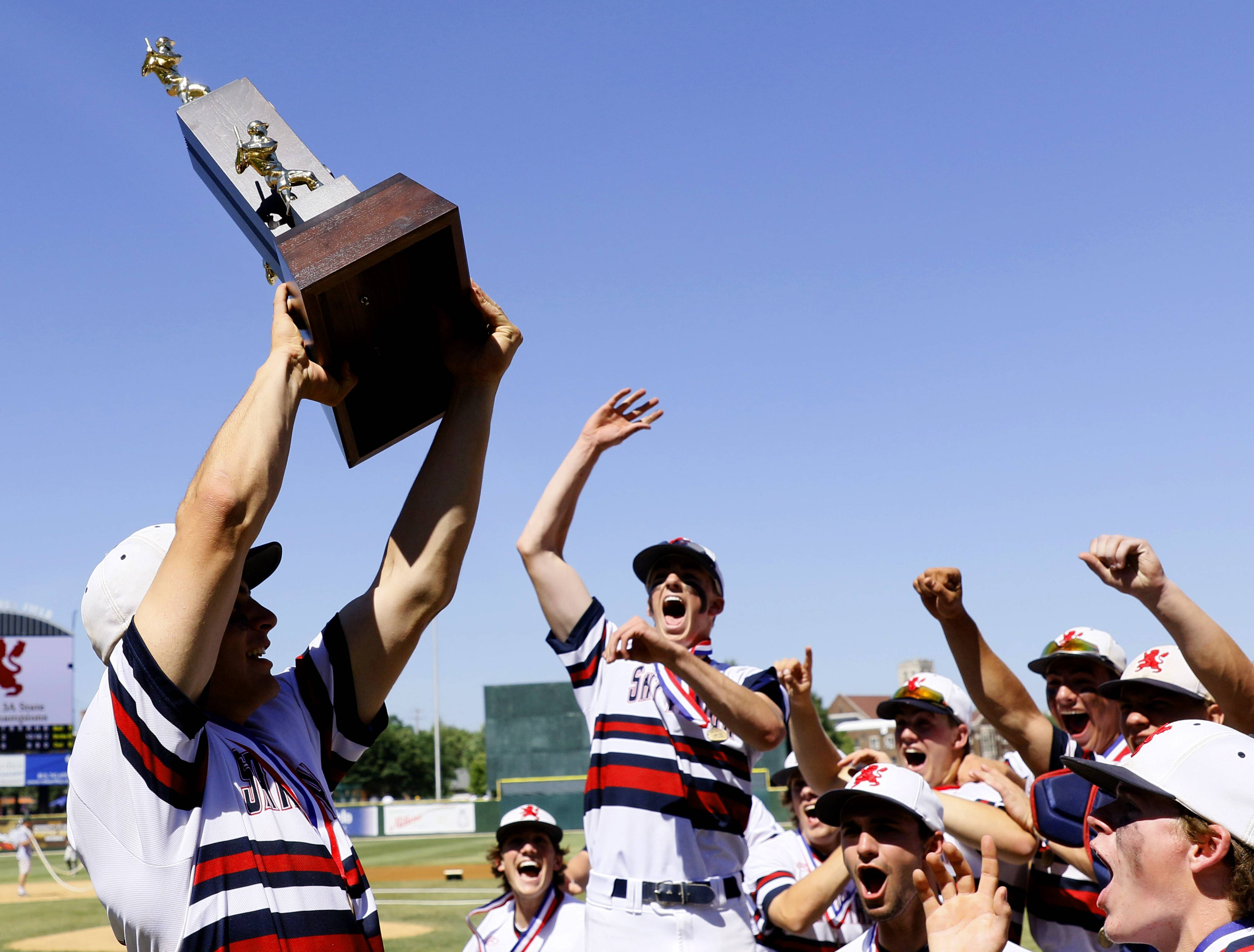 St. Viator players prepare to celebrate their Class 3A baseball state championship after a 10-8 win over Marian Catholic on Saturday in Joliet.