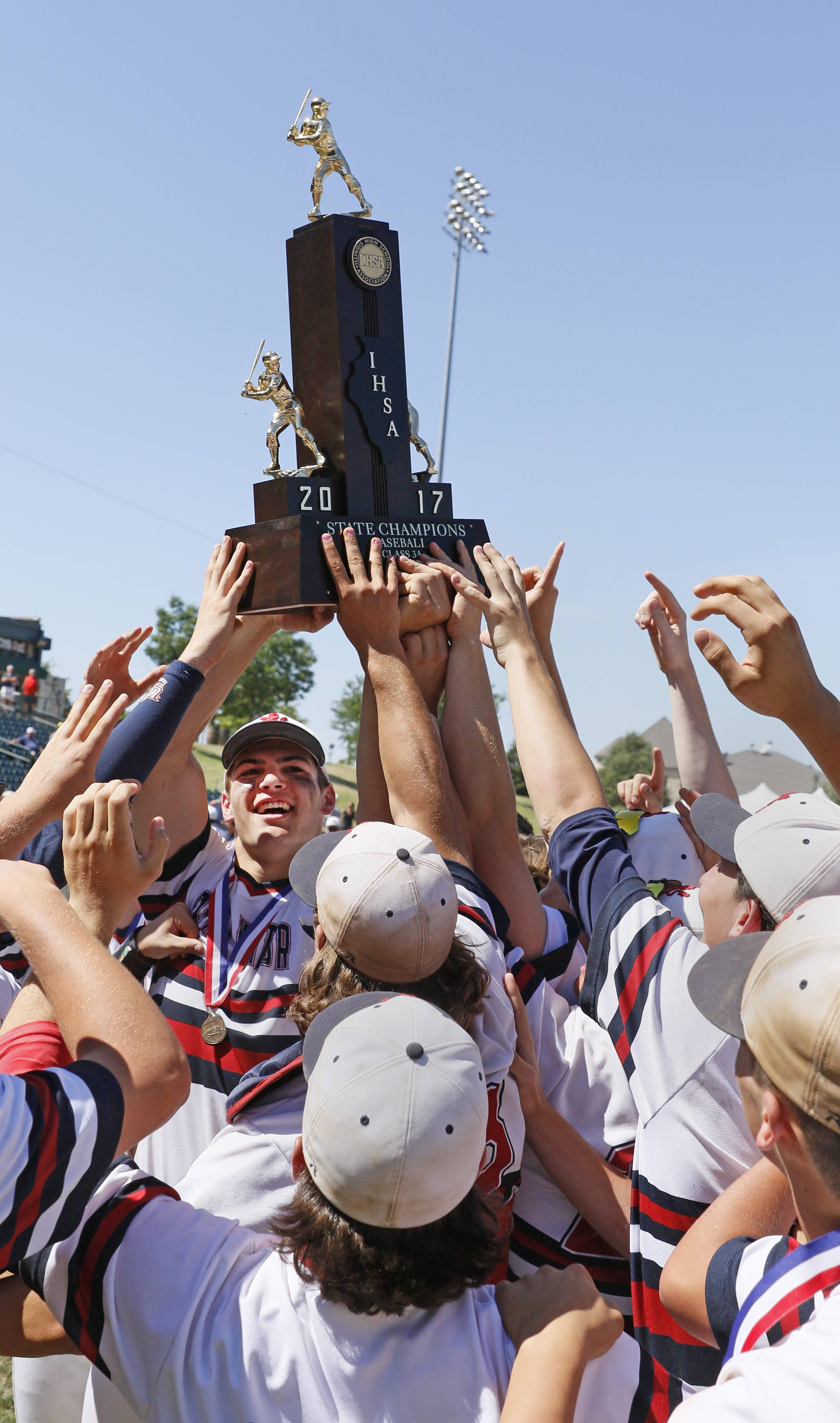 St. Viator senior Cole Kmet holds the Class 3A state championship trophy after the Lions' 10-8 win over Marian Catholic on Saturday in Joliet.