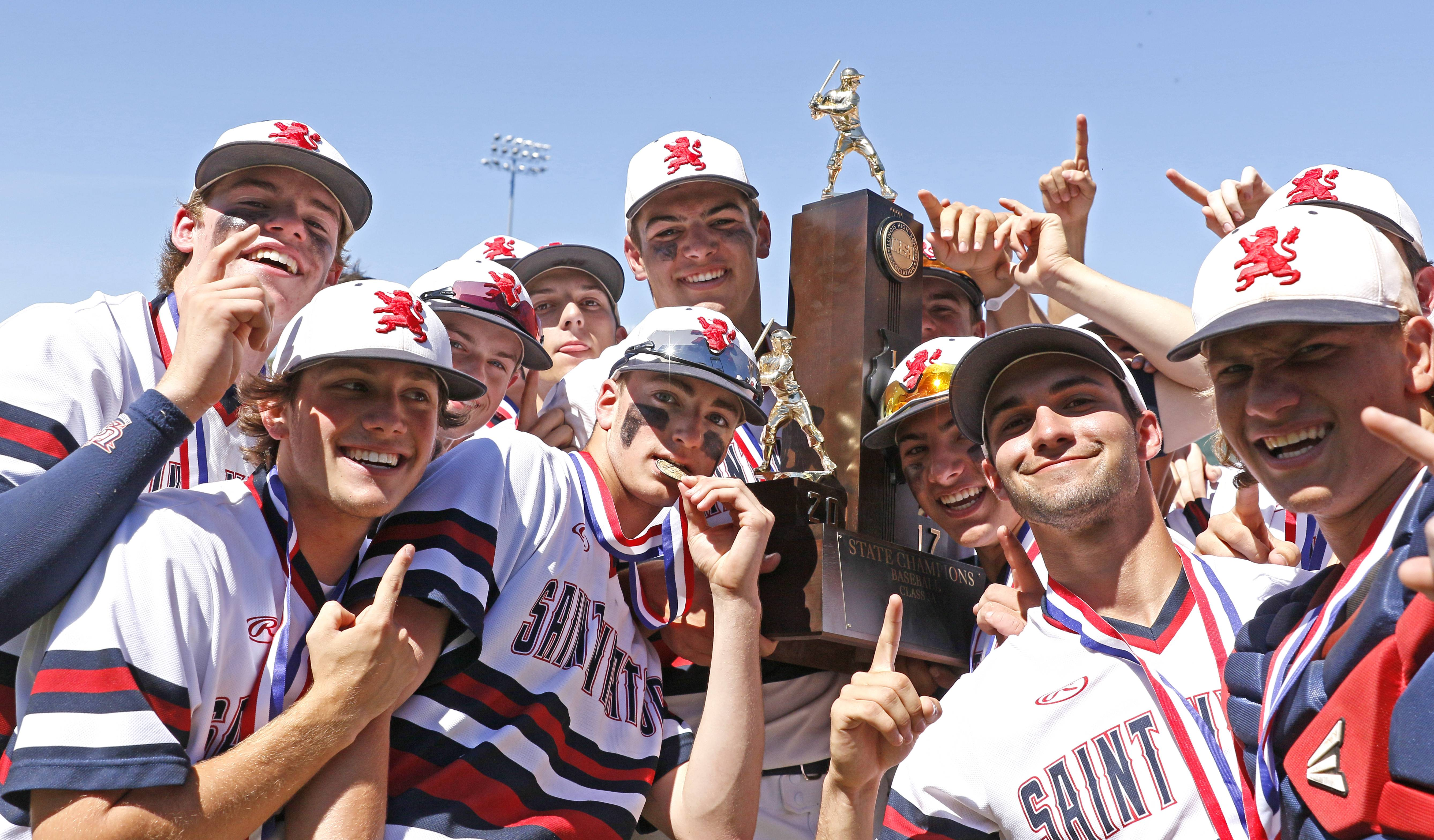 St. Viator's baseball players celebrate their Class 3A state championship after a  10-8 win over Marian Catholic on Saturday in Joliet.