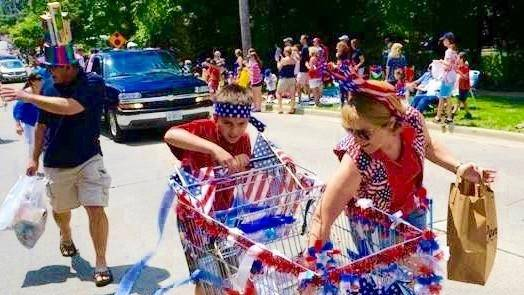 Precision marchers fill their carts with non perishable groceries donated by the crowds at the Glen Ellyn 4th of July Parade.Jean Jeske