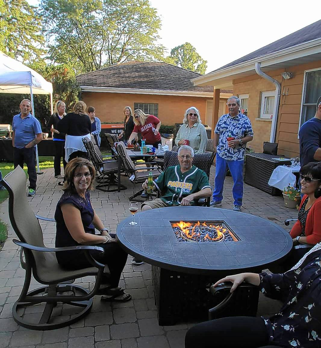 A Rolling Meadows family enjoys a catered, Weber On Wheels party in their backyard. The family won a previous Get Your Summer On promotion.