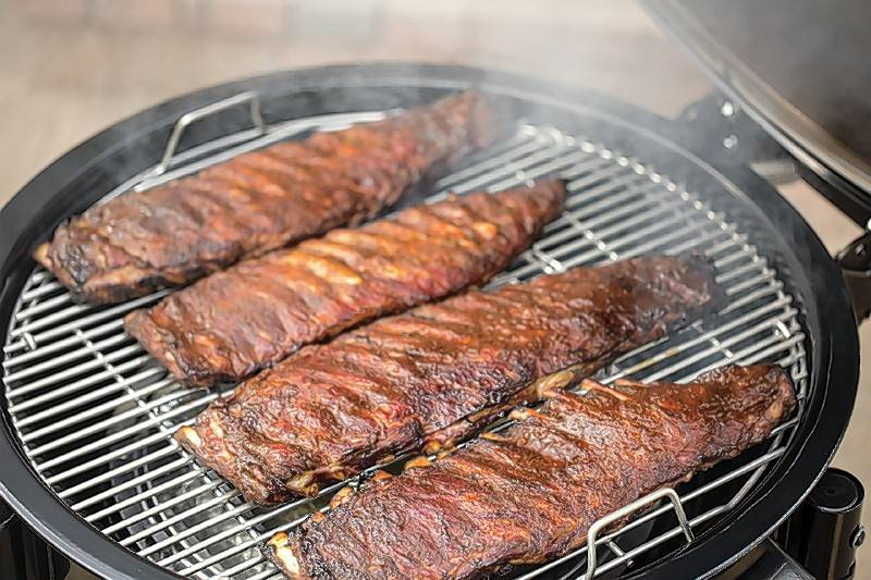 Slabs of ribs, definitely a party favorite, slow cook on a Weber grill.