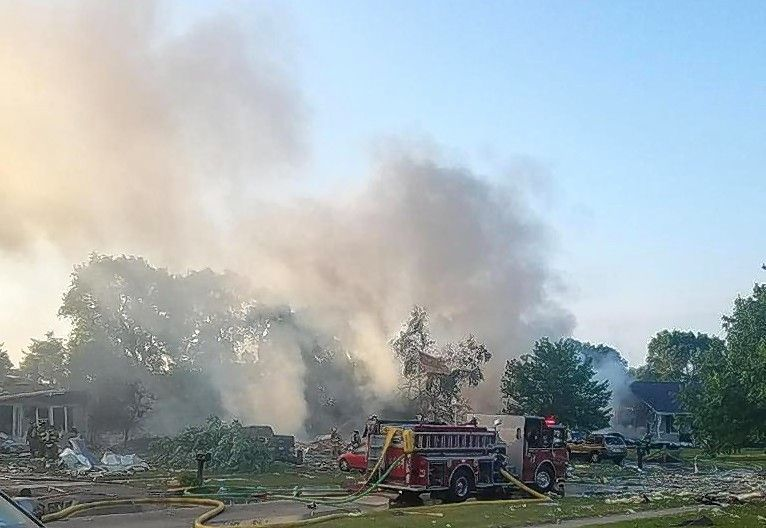 An explosion Sunday morning in the 500 block of 7th Avenue in Marengo damaged more than 50 nearby homes, including four that were on fire, officials said.