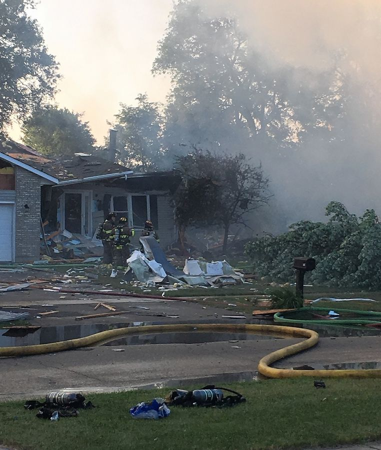 Eighteen fire departments and other agencies assisted Sunday at the scene of an explosion and house fire in the 500 block of 7th Avenue in Marengo.