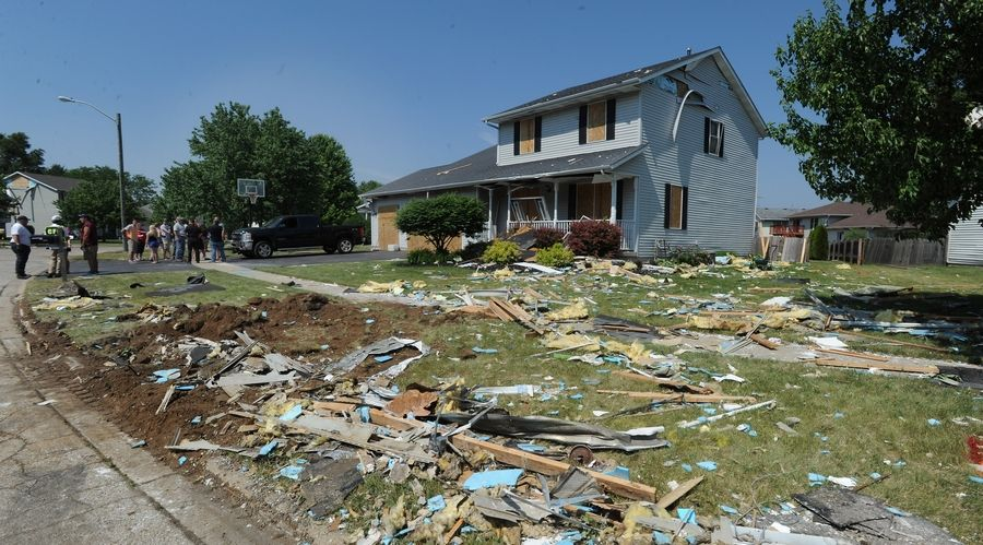 Neighbors talk about what they went through as debris litters the ground in their neighborhood.
