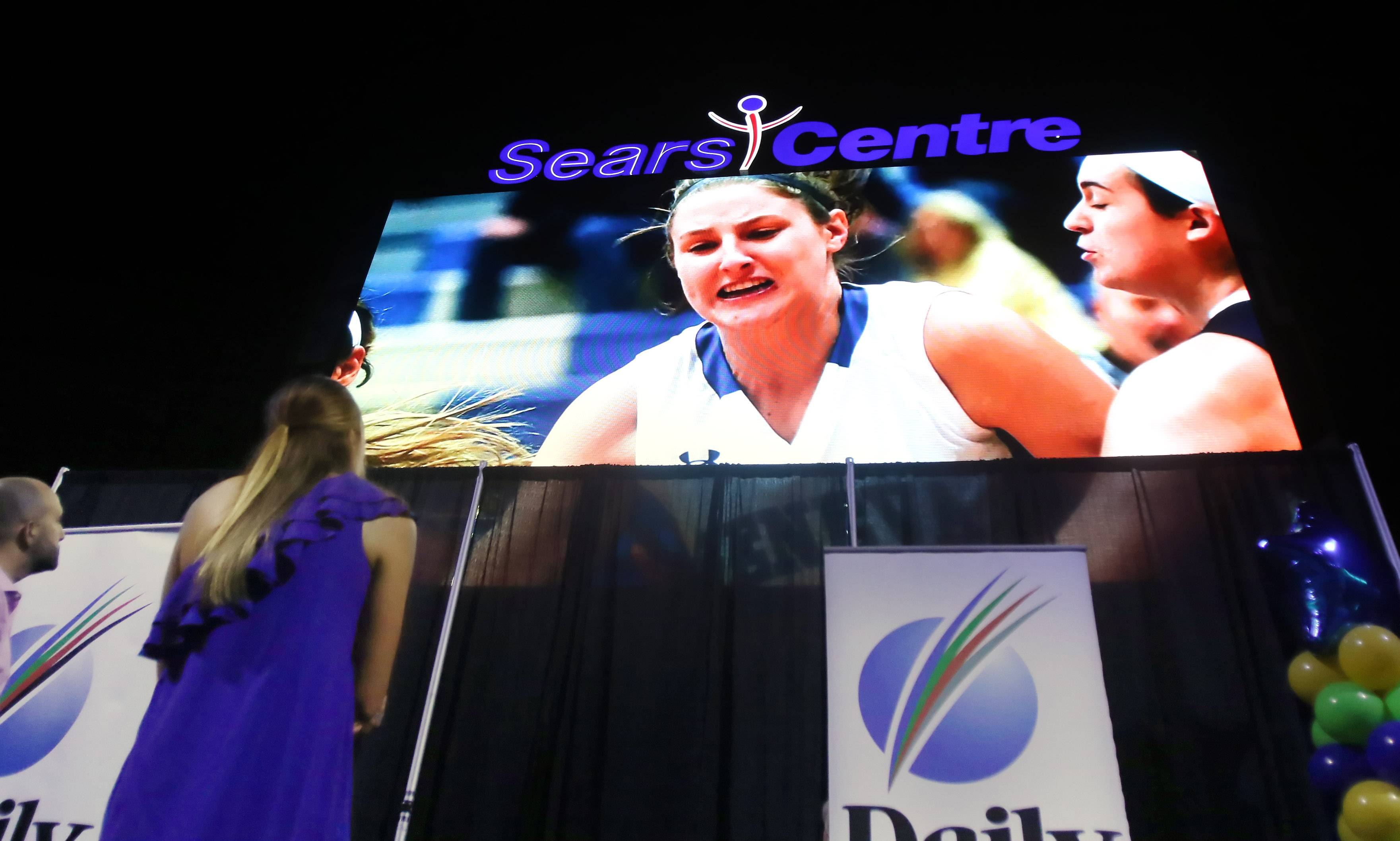 Geneva High School athlete Grace Loberg watches a video of her highlights after winning Sweetest Moment award during the Daily Herald Preps Sports Excellence Awards Monday night at the Sears Centre Arena in Hoffman Estates. About 1,000 people attended the banquet recognizing the best athletes and coaches in the area for the past school year.
