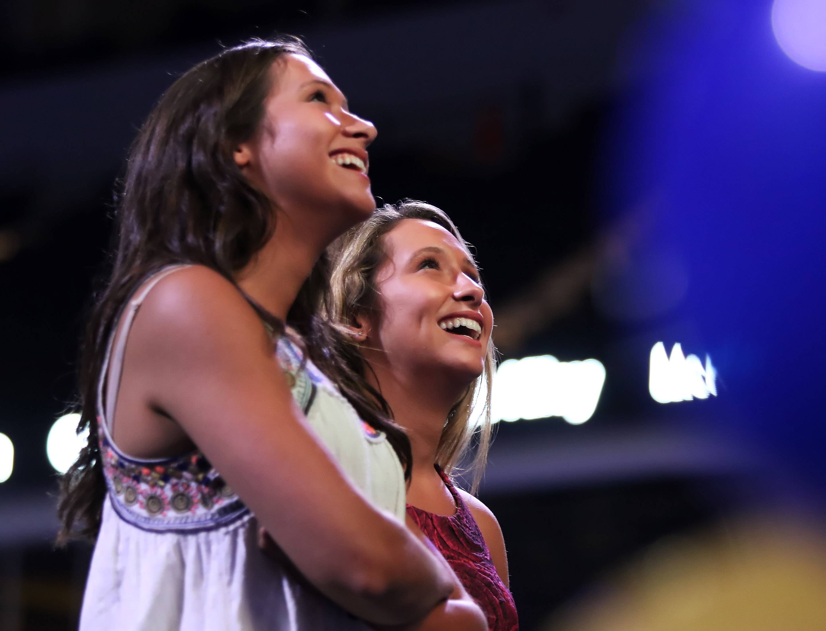 Libertyville High School athletes Claire and Kelly Keefe watch a video after winning the Overcoming Obstacles award during the Daily Herald Preps Sports Excellence Awards Monday night at the Sears Centre Arena in Hoffman Estates. About 1,000 people attended the banquet recognizing the best athletes and coaches in the area for the past school year.