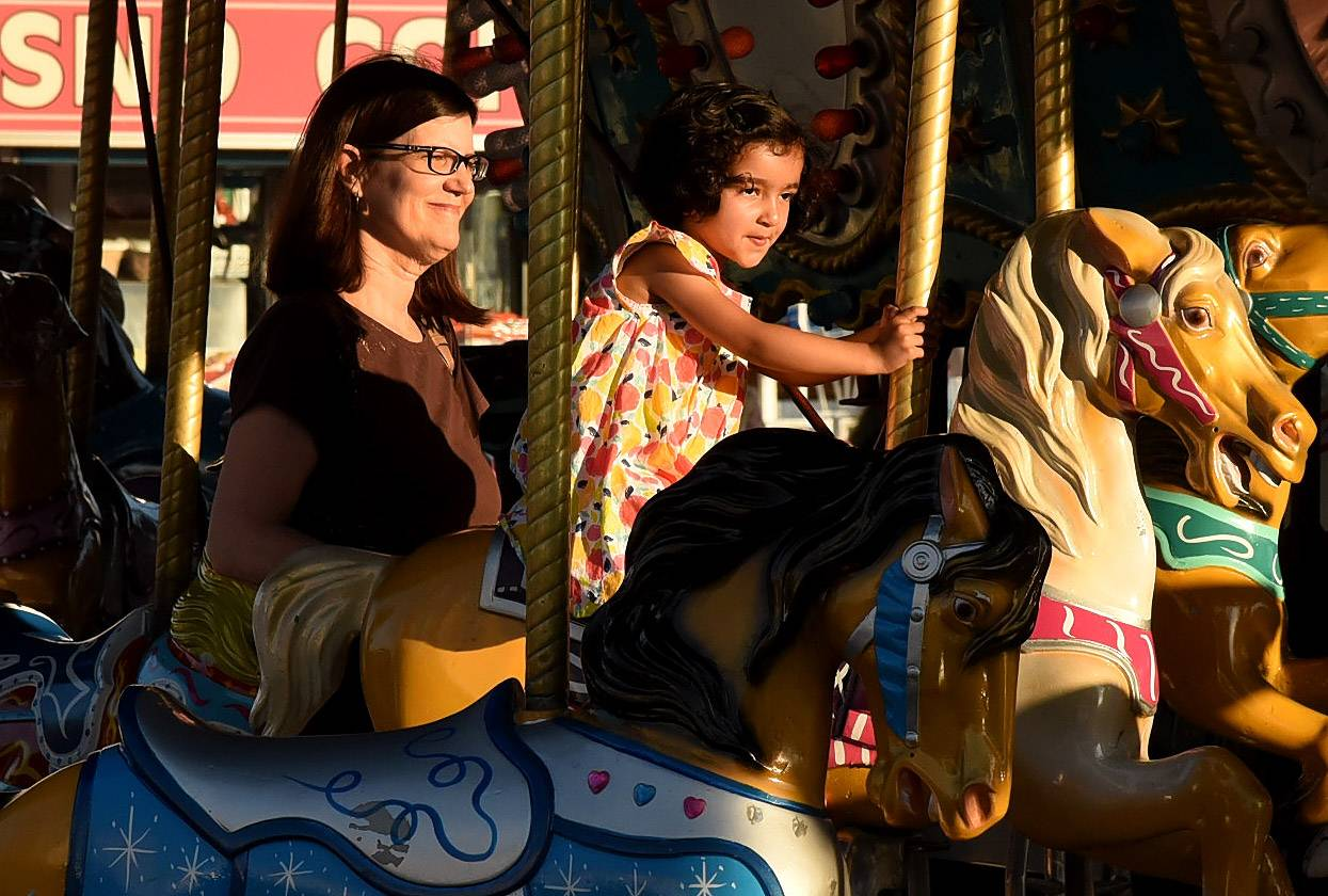 Patty Chattha of Des Plaines rides the Merry-Go-Round with her niece Aisha Chattha at last year's Rotary Fest. It's the first big festival of the summer in the Northwest suburbs.