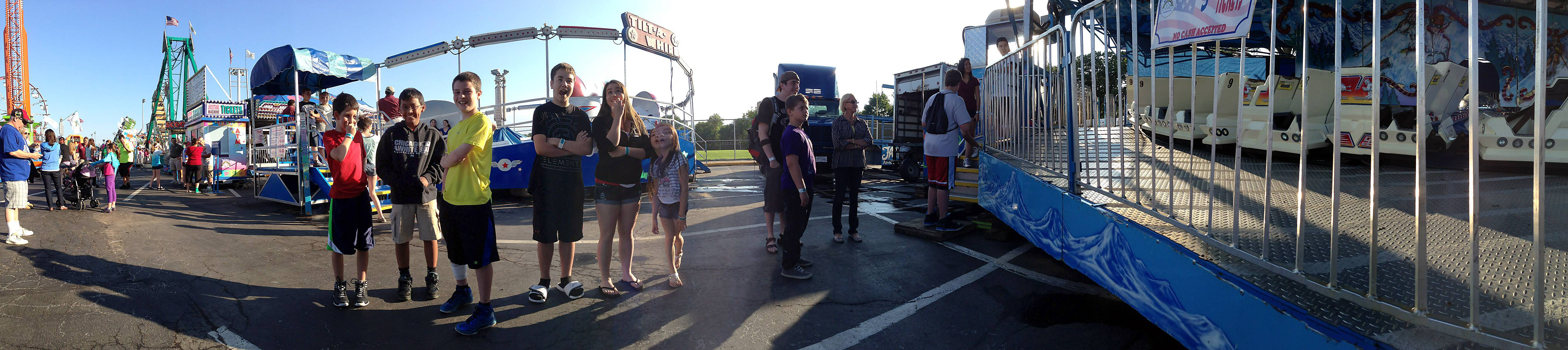 Youths get ready to get their thrill on riding the Matterhorn at the Elk Grove Village 2013 Rotary Fest.