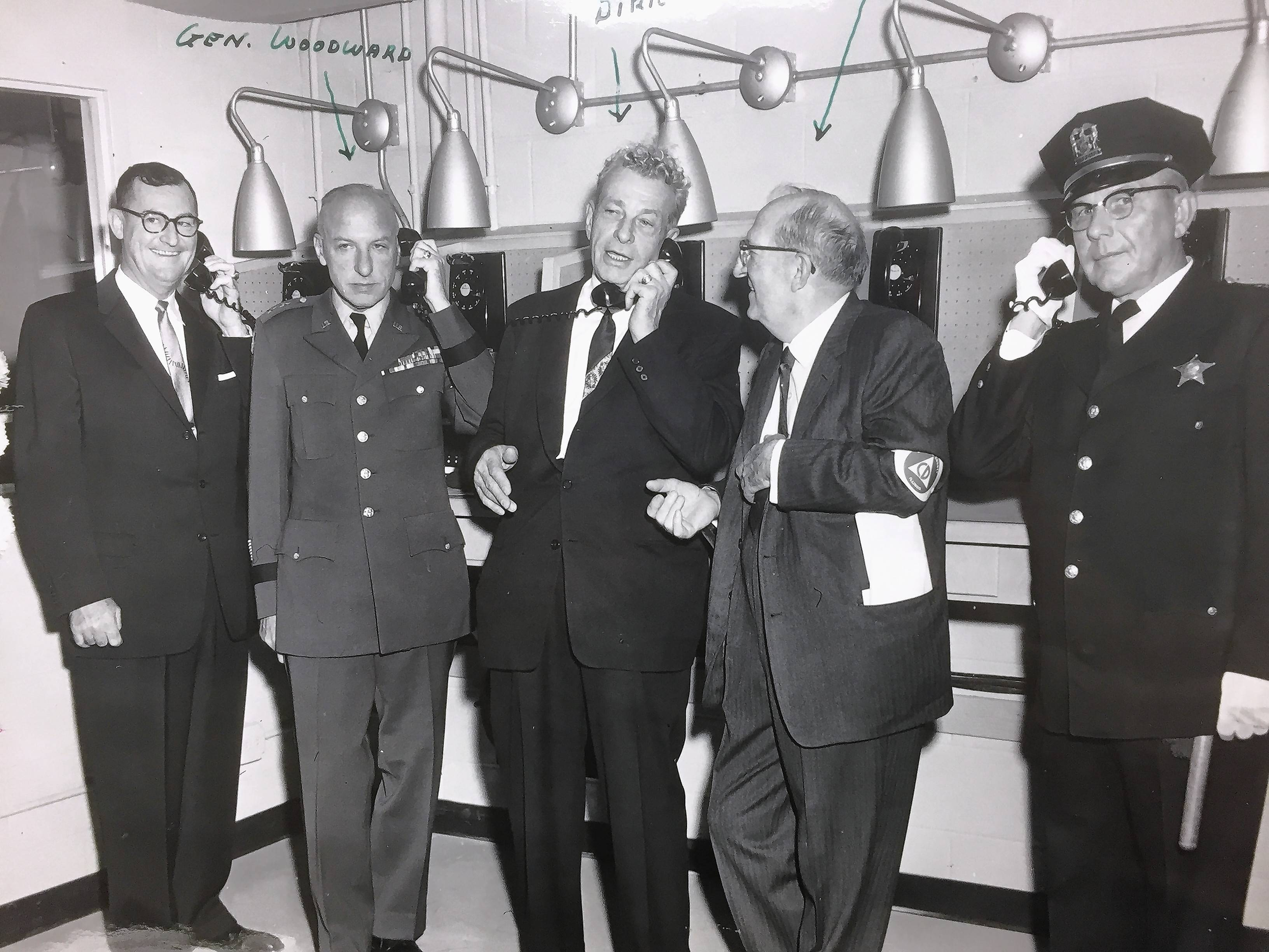U.S. Senator Everett Dirksen, center, and other state officials test out the Wheaton Cold War bunker after its 1958 dedication.