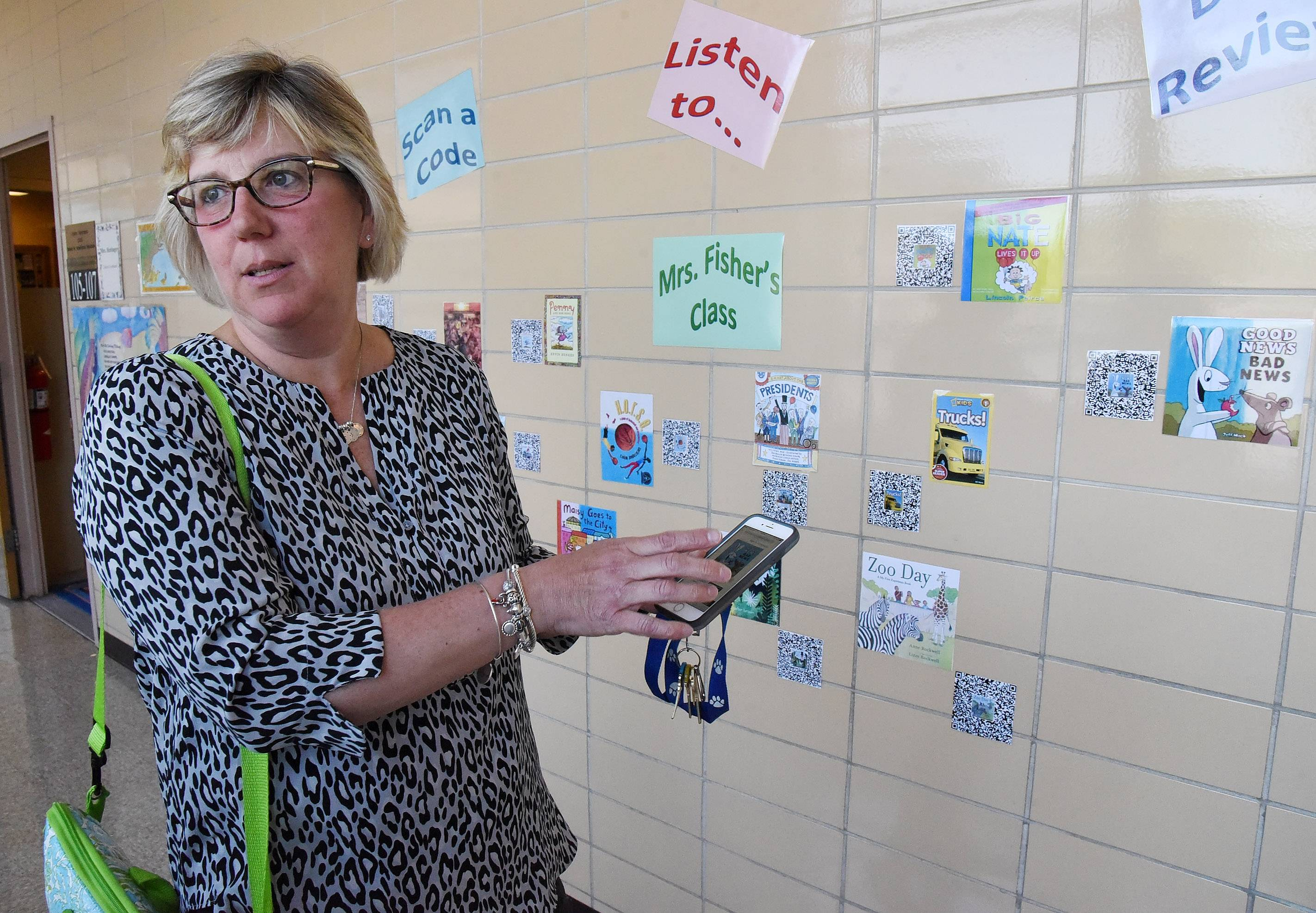 Chris Bremner explains how she helped elementary students record book reviews that can be accessed through QR codes at her Scan a Code wall.