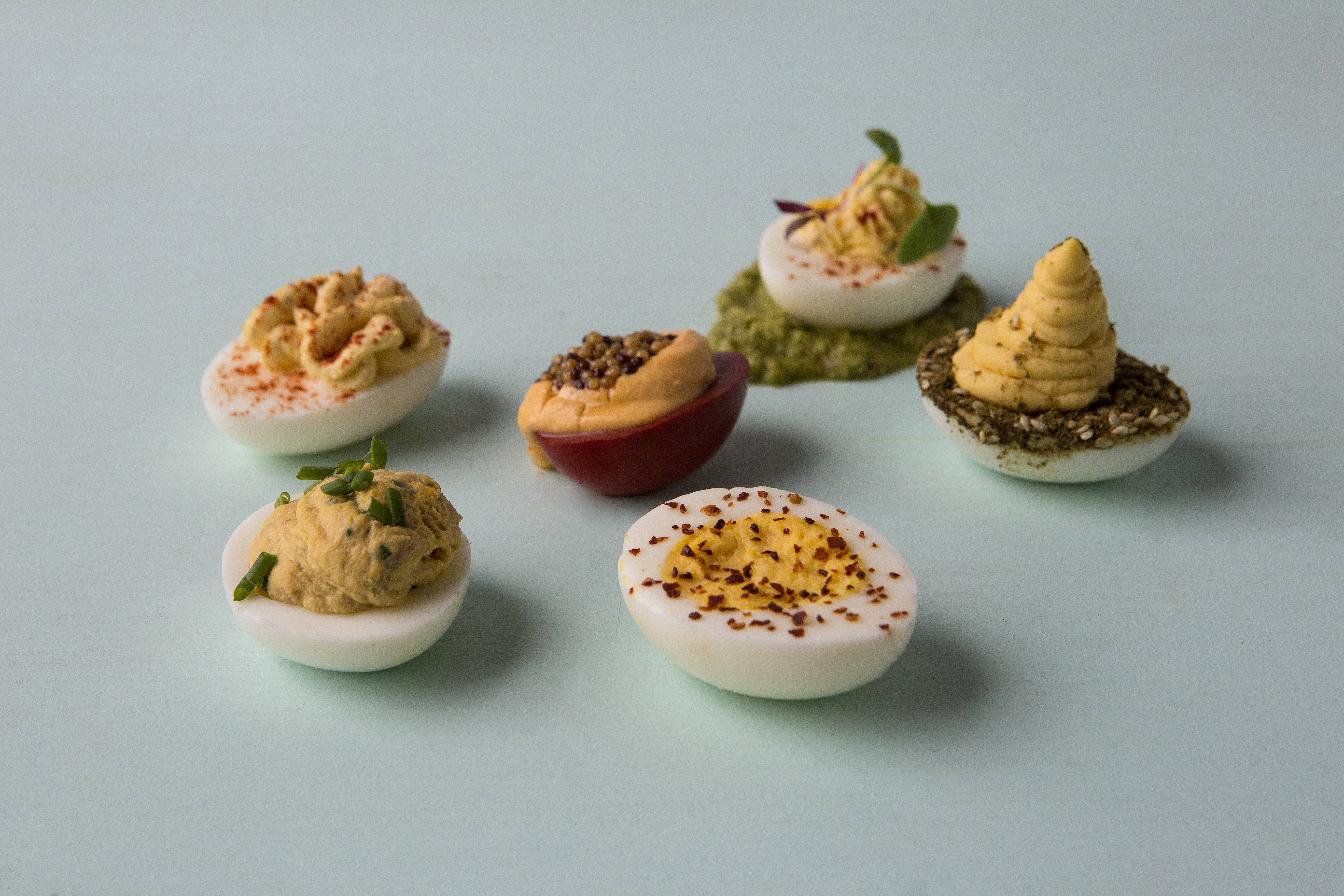 Why choose between them? Make a sampler for your next get-together. From left to right: Horseradish Deviled Eggs (in back); Lourdes's Deviled Eggs With Foie Gras and Tuna; Proof's Beet-Pickled Deviled Eggs; Less-Devilish Eggs; Homestead Deviled Eggs and Hummus Deviled Eggs.