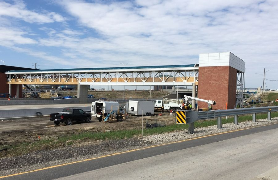 Workers are constructing a pedestrian overpass at Barrington Road and I-90 where a Pace park-and-ride will be located to accommodate express buses.