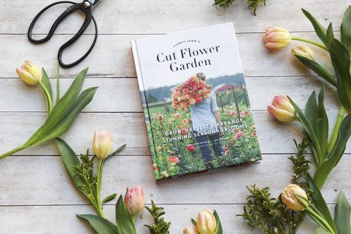 "This 2017 photo provided by Chronicle Books shows Erin Benzakein's book, ""Floret Farm's Cut Flower Garden,"" and is surrounded by tulips, one of the first bloomers each spring, in San Francisco, Calif. (Irene Kim/Chronicle Books via AP)"