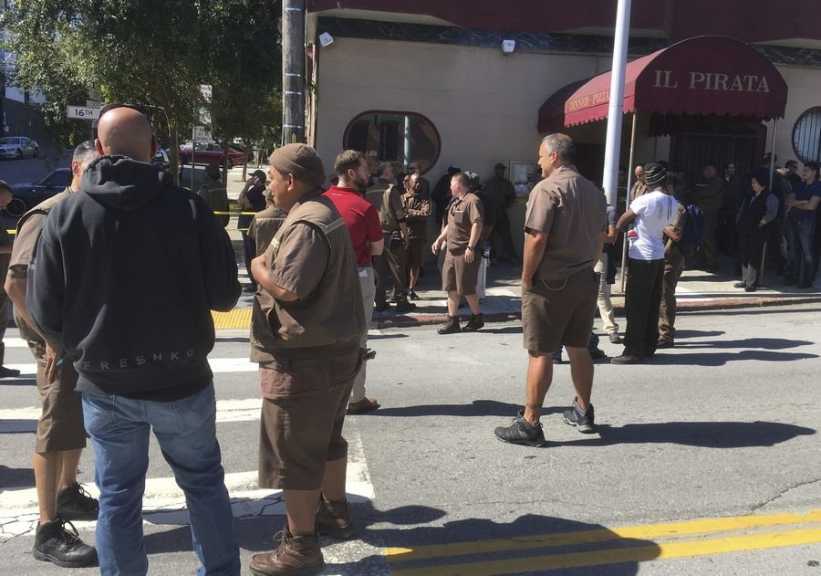 UPS workers gather outside after a reported shooting  at a UPS warehouse and customer service center in San Francisco on Wednesday, June 14, 2017.   San Francisco police confirmed a shooting at the facility in the Potrero Hill neighborhood but didn't release information on injuries or the shooter.