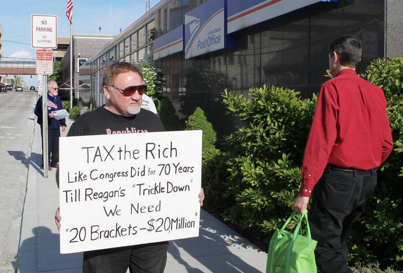 "James Hodgkinson of Belleville protests outside the United States post office in downtown Belleville in this file photo. Hodgkinson was part of the ""99%"" group drawing attention to the disproportionate amount of money and political power the top 1 percent of Americans have acquired. He has been identified as the gunman who attacked congressmen Wednesday."