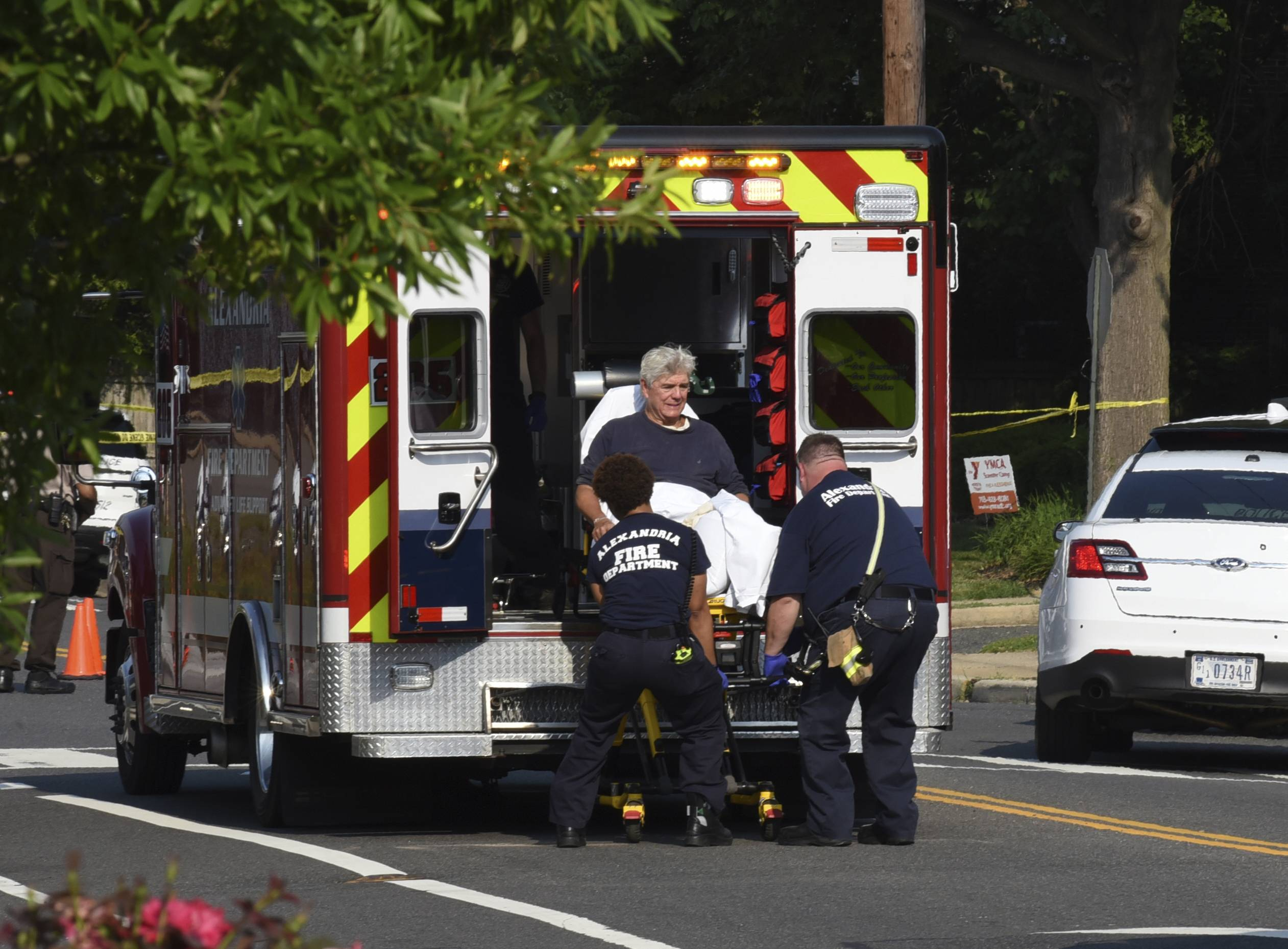 Rep. Roger Williams, R-Texas, is placed into an ambulance at the scene of a shooting at a baseball field in Alexandria, Va., Wednesday.