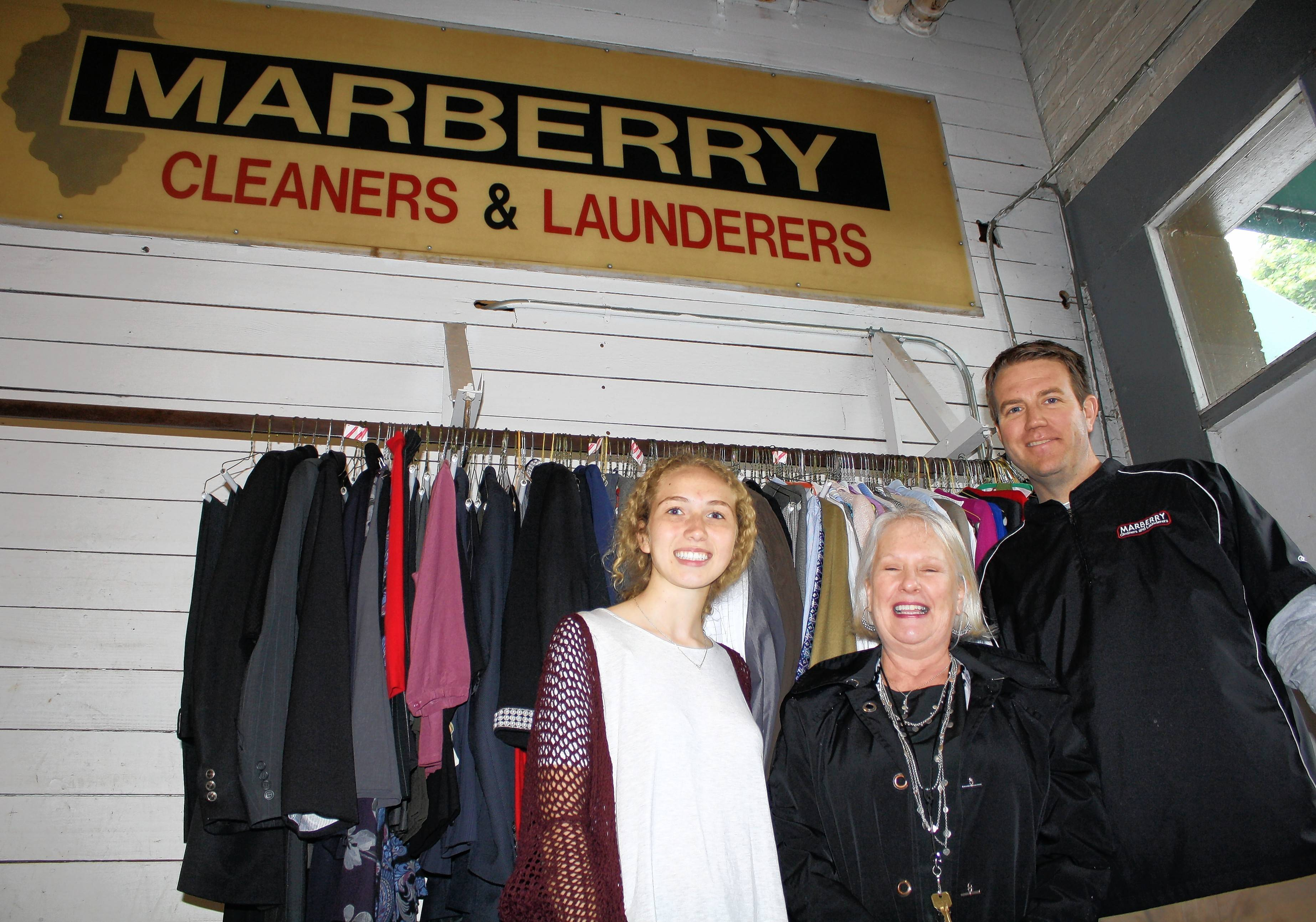 St. Charles East student Courtney Hydar joins Batavia Clothes Closet Executive Director Diane Upton and Marberry owner Dave Marberry at the pickup of donations for the clothing drive.