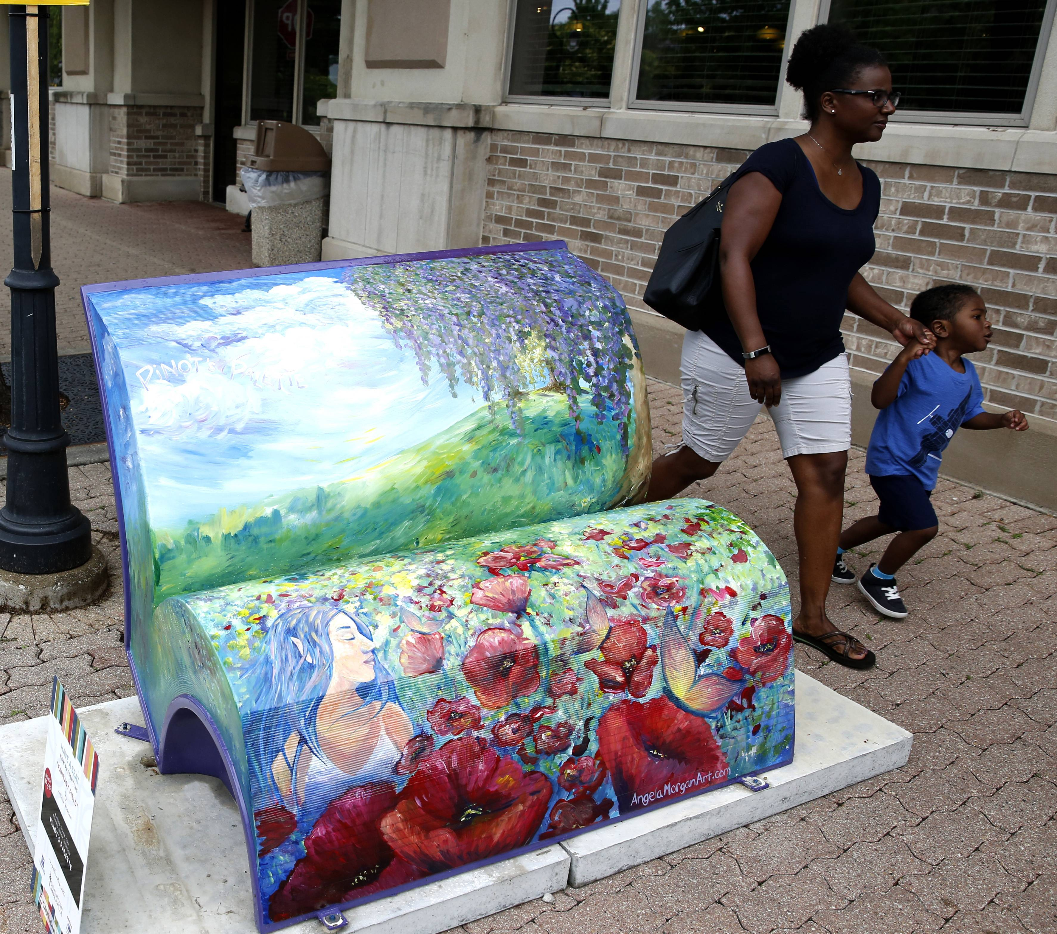 """Fantasy Field"" by Angela Morgan is one of 15 book bench sculptures set to grace downtown Naperville until mid-September. The sculptures were installed early Friday morning."