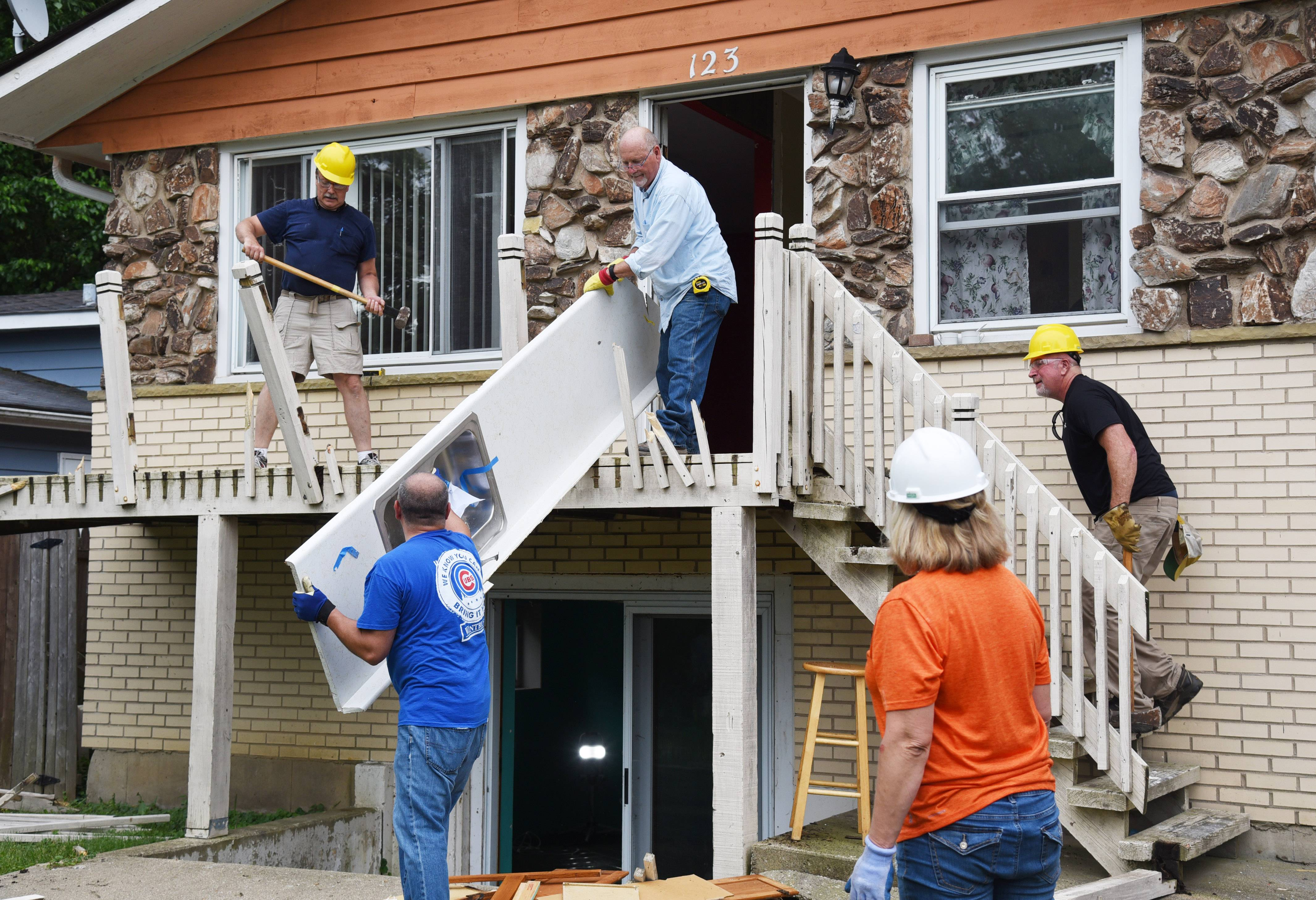 Tradesmen and other volunteers on Friday and Saturday are working on a house on Woodland Drive in Round Lake Beach that will be rehabbed and resold at an affordable price.