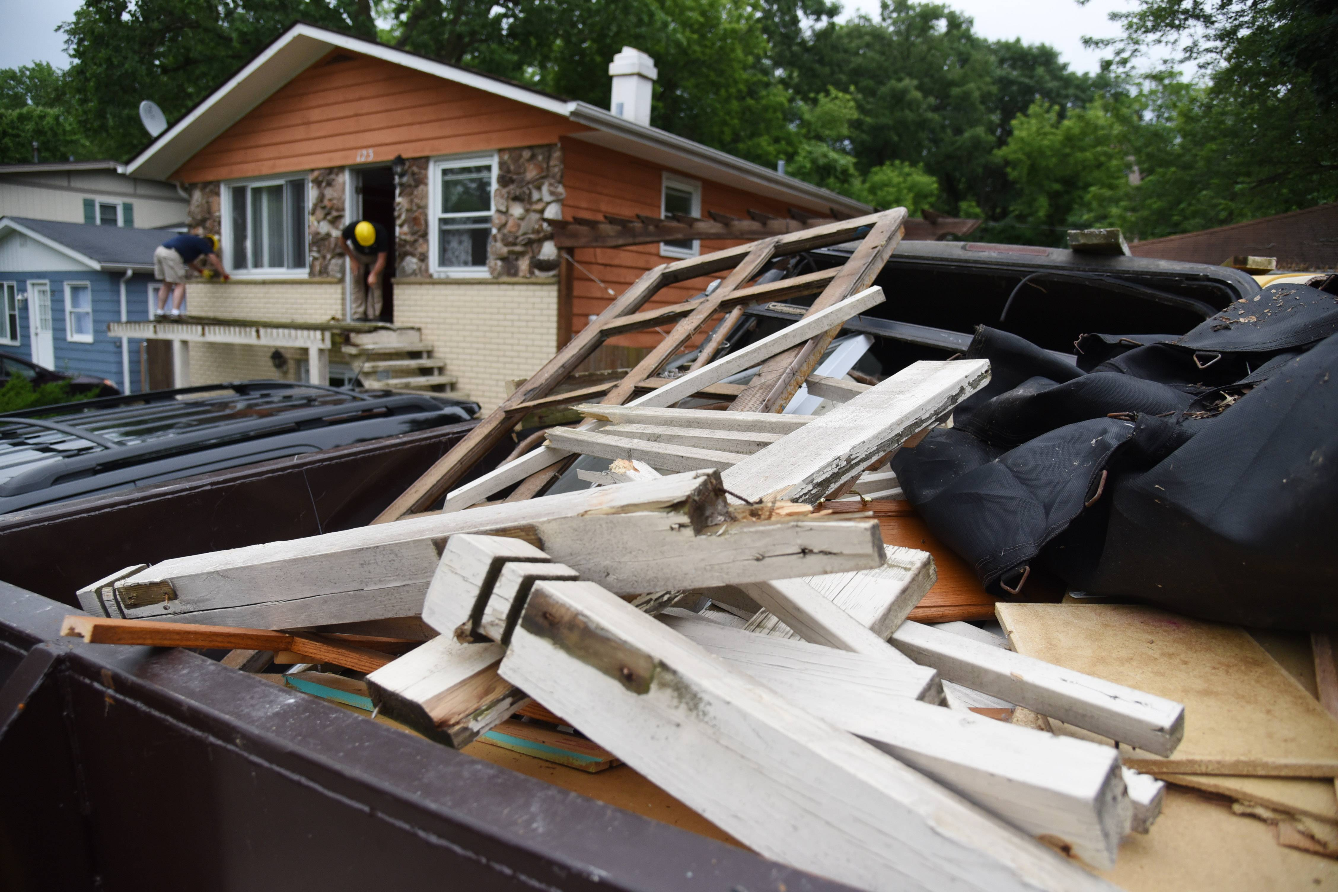 A Dumpster was quickly filled with debris Friday morning by volunteers working with the Affordable Housing Corporation of Lake County to rehab the house on Woodland Drive in Round Lake Beach.